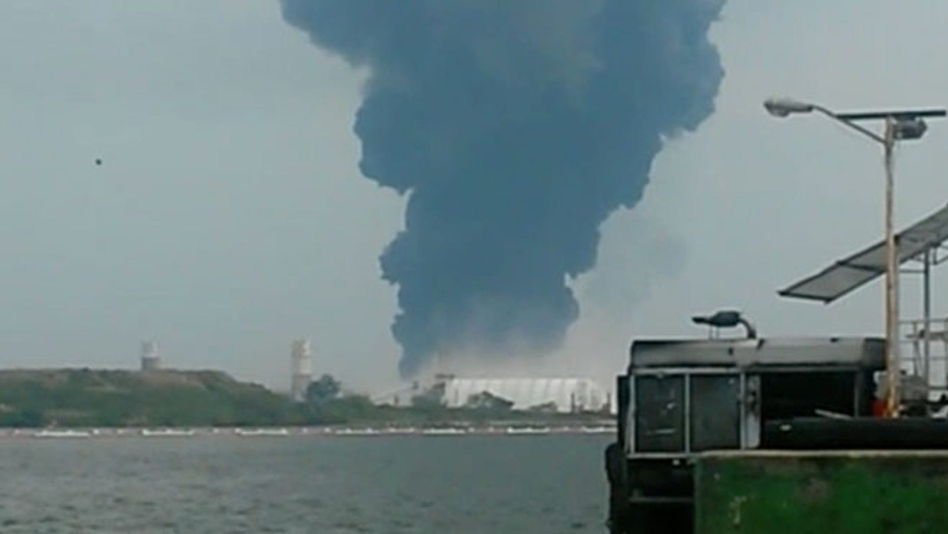 BEST QUALITY AVAILABLE  - In this video grab a large plume of smoke rises from the Mexican State oil company Petroleos Mexicanos' petrochemical plant after an explosion in Coatzacoalcos, Mexico, Wednesday, April 20, 2016. The explosion killed several people, injuring dozens and sending flames and a toxin-filled cloud into the air, officials said. (Inmel Enoc via AP)