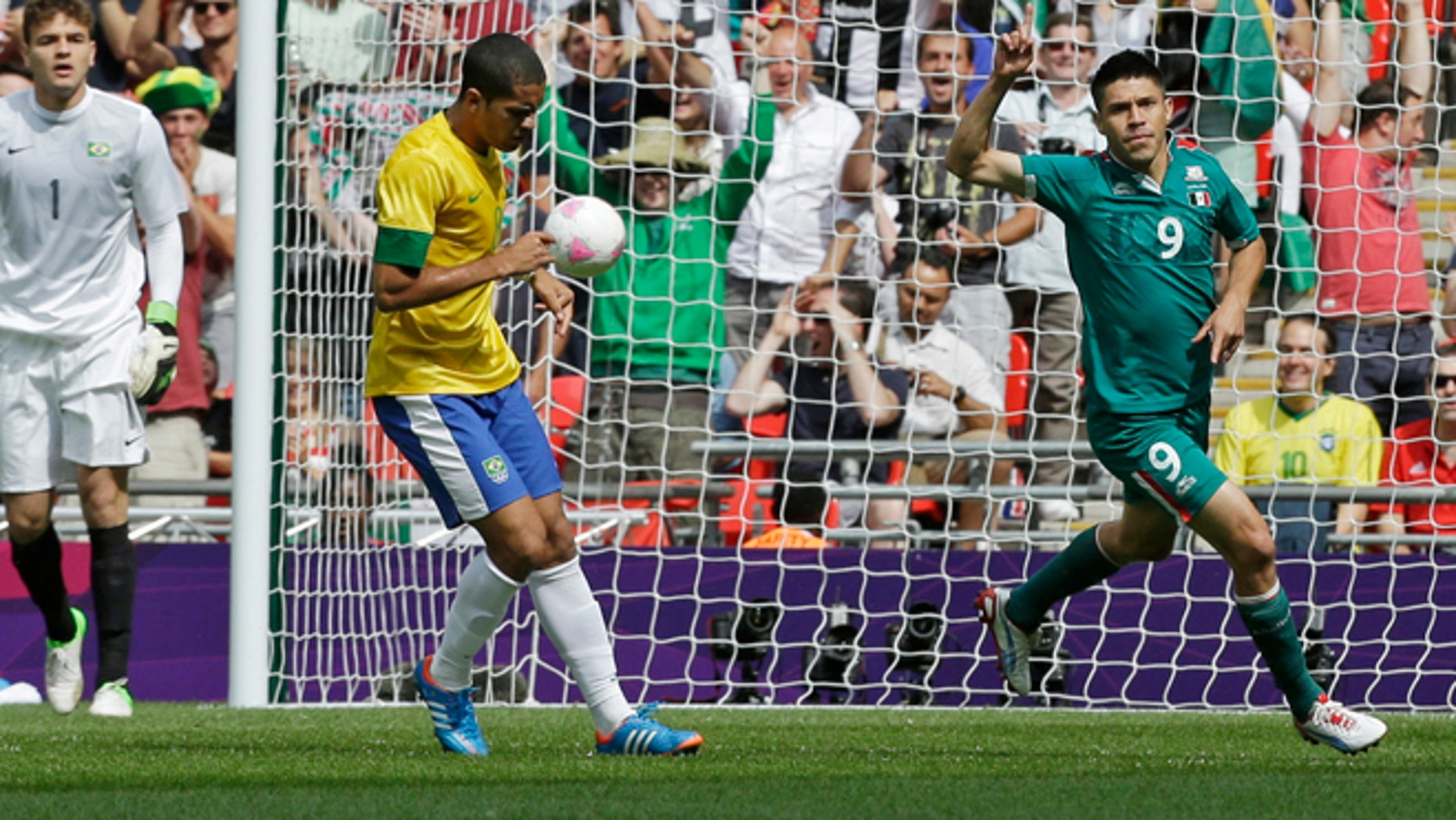 Aug. 11, 2012: Mexico's Oribe Peralta (9) celebrates his goal during the men's soccer final against Brazil at the London Olympics.