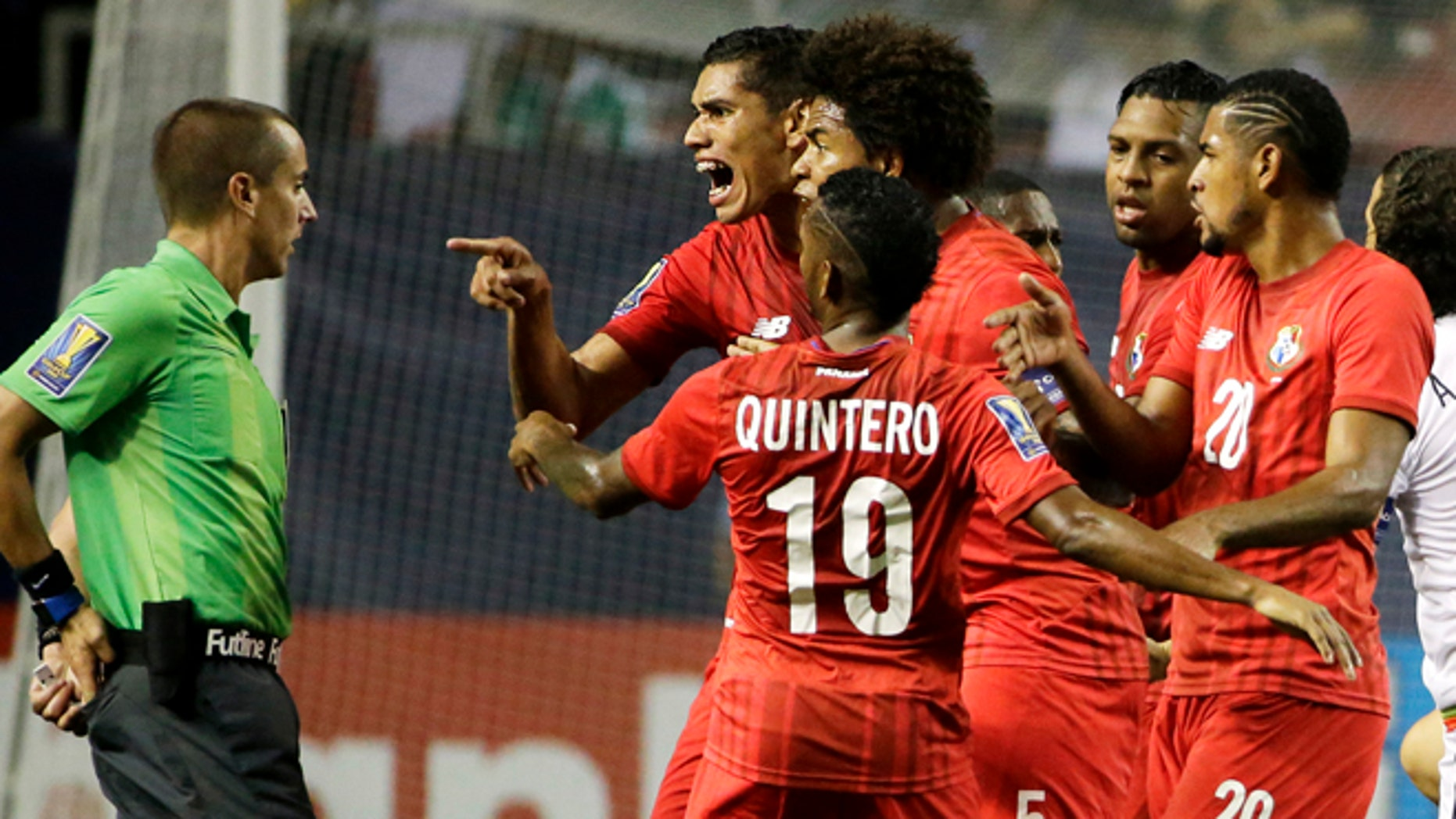 Panama's Valentin Pimentel, center right, points at referee Mark Geiger, who had given a red card to Panama's Luis Tejada, not seen, during the first half of Panama's CONCACAF Gold Cup soccer semifinal against Mexico on Wednesday, July 22, 2015, in Atlanta. (AP Photo/David Goldman)