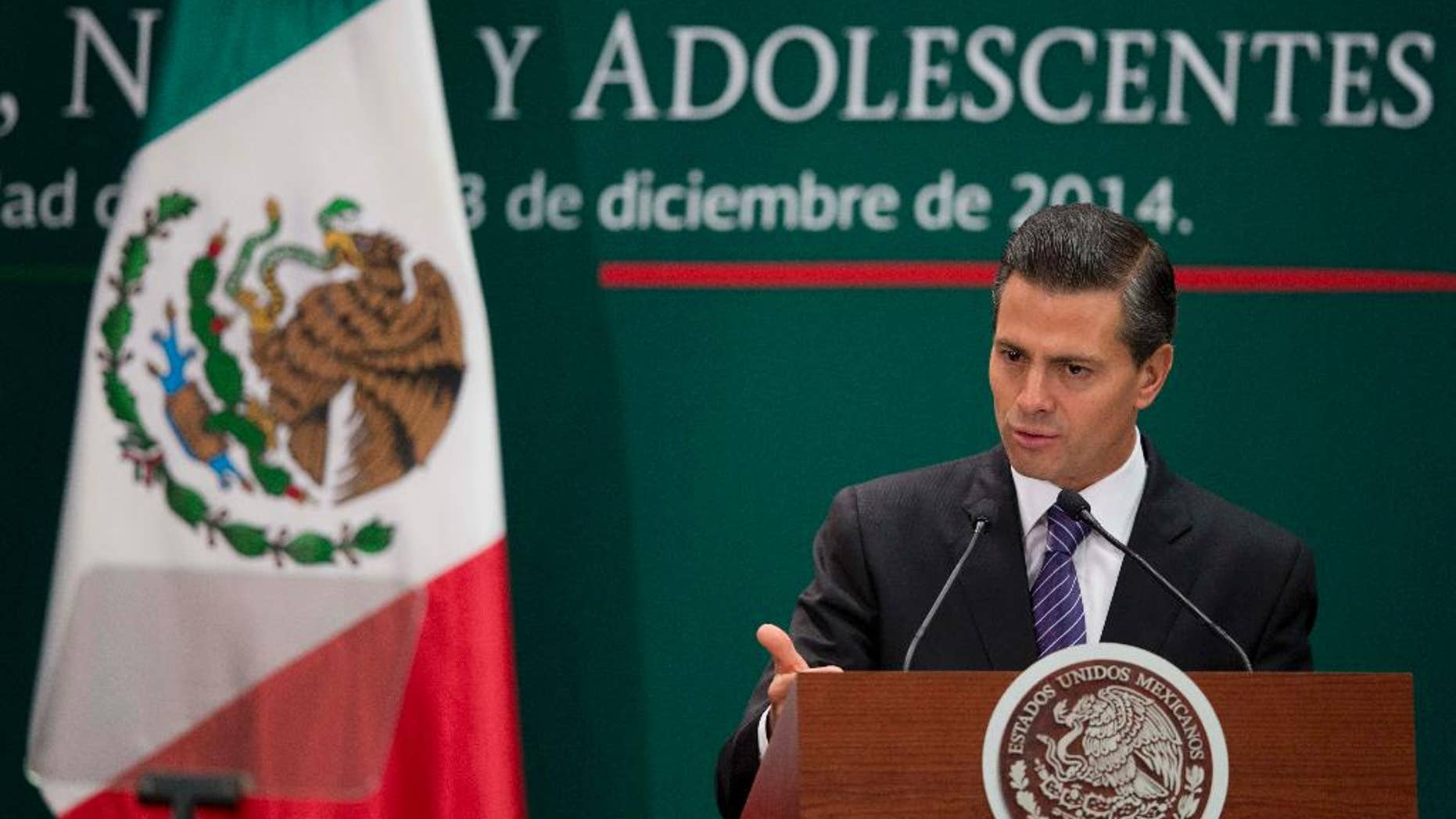 Mexican President Enrique Pena Nieto speaks during a signing ceremony for a new law that further protects children at Los Pinos presidential residence in Mexico City, Wednesday, Dec. 3, 2014. (AP Photo/Eduardo Verdugo)