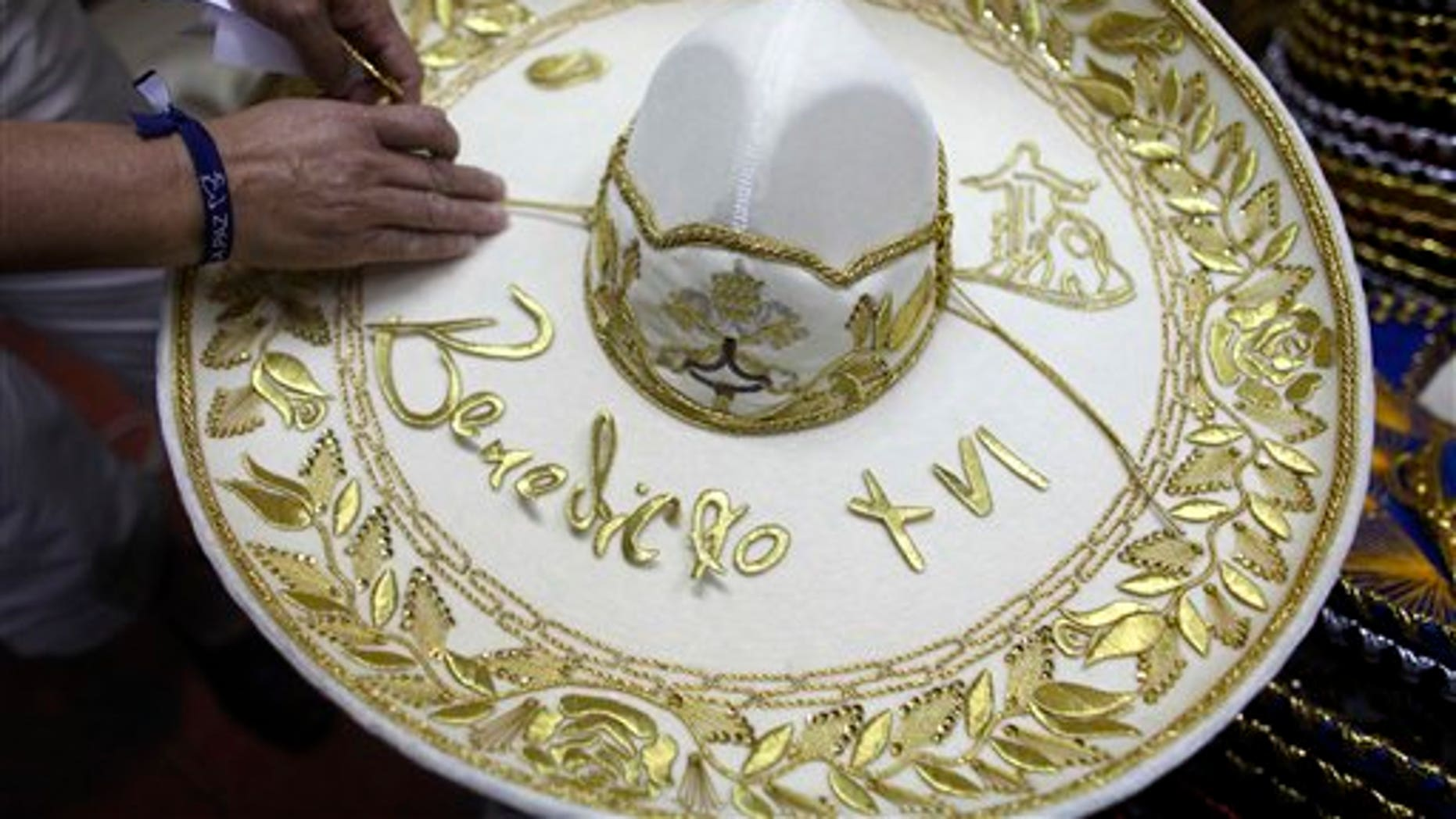 February 29, 2012: Maria de la Luz Yepes shows one of the sombrero's that will be given to Pope Benedict XVI, at her sombrero shop in the town of San Francisco del Rincon, near Leon, Mexico.