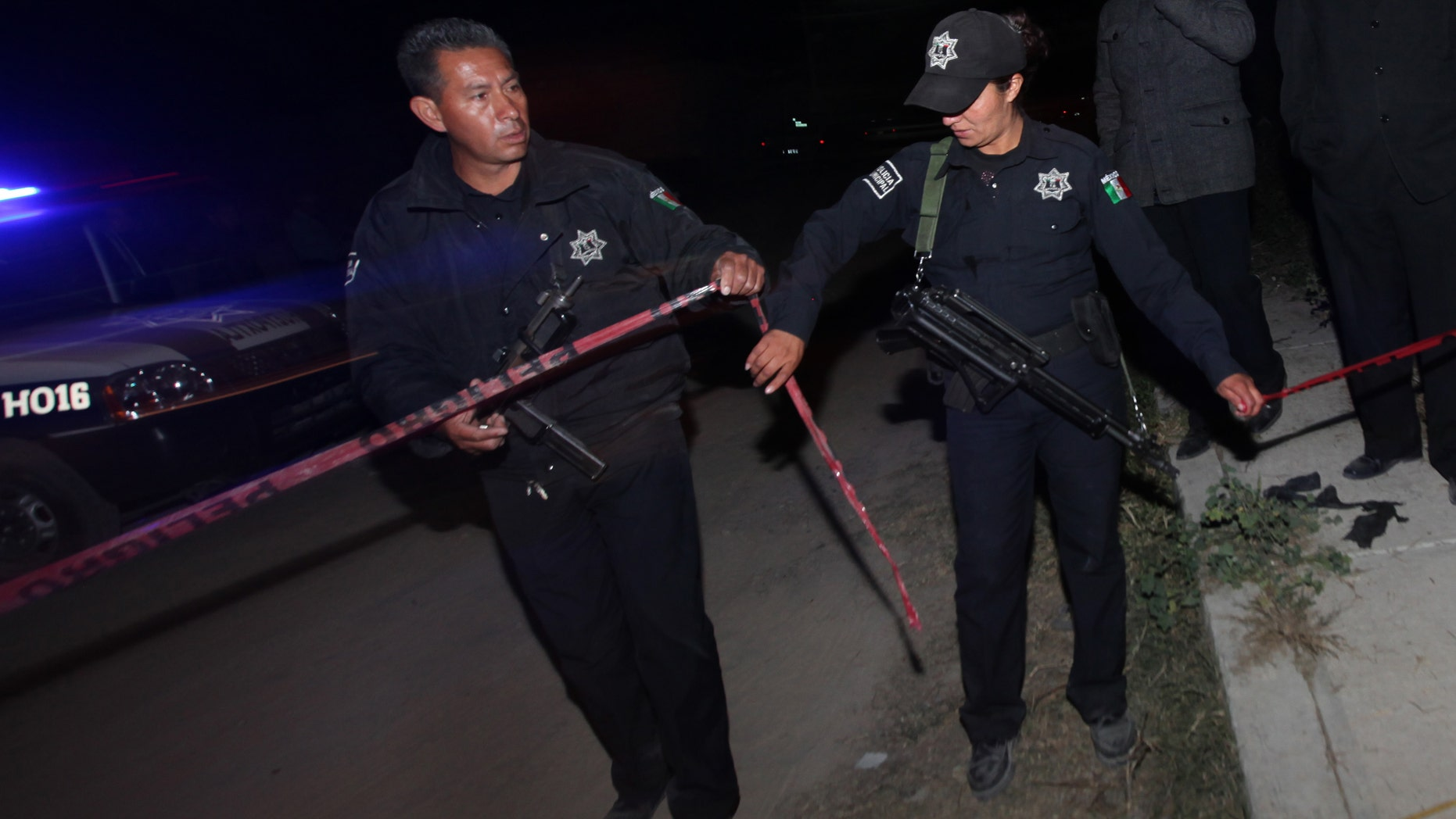Police agents cordon off an area in the village of Hueypoxtla, Mexico, Wednesday, Dec. 4, 2013. Mexican troops and federal police kept a nighttime vigil guarding a rural field where thieves abandoned a stolen shipment of highly radioactive cobalt-60, while officials began planning the delicate task of safely recovering the dangerous material. The cargo truck hauling the cobalt-60 was stolen from a gas station Tuesday in the neighboring state of Hidalgo, about 40 kilometers (24 miles) from where the material was recovered. (AP Photo/Marco Ugarte)