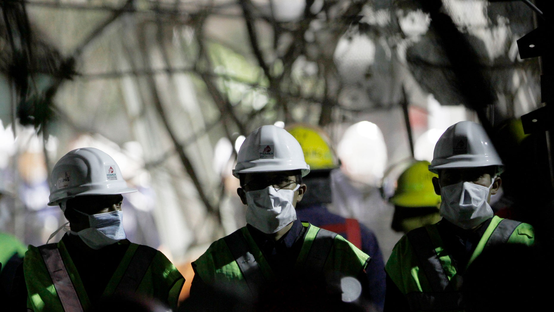 Employees cull through debris searching for office documents amid the rubble left from an office building explosion in Mexico City, Feb. 2. The death toll is now at 37.