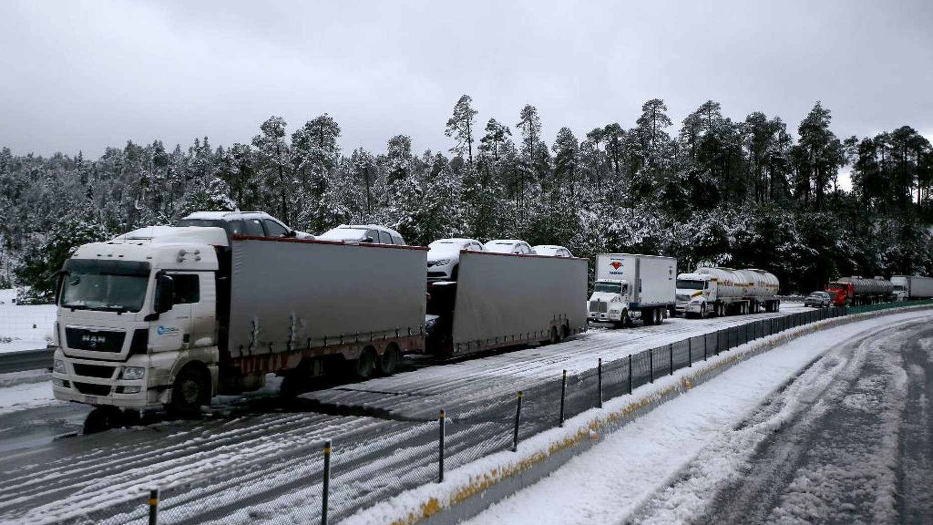 Traffic stands still due to snow, in Rio Frio, Mexico, Thursday, March 12, 2015. One of the main access roads to the city of Mexico was closed on Thursday after a snowstorm in the mountainous area east of the capital which reached unusual levels. (AP Photo)