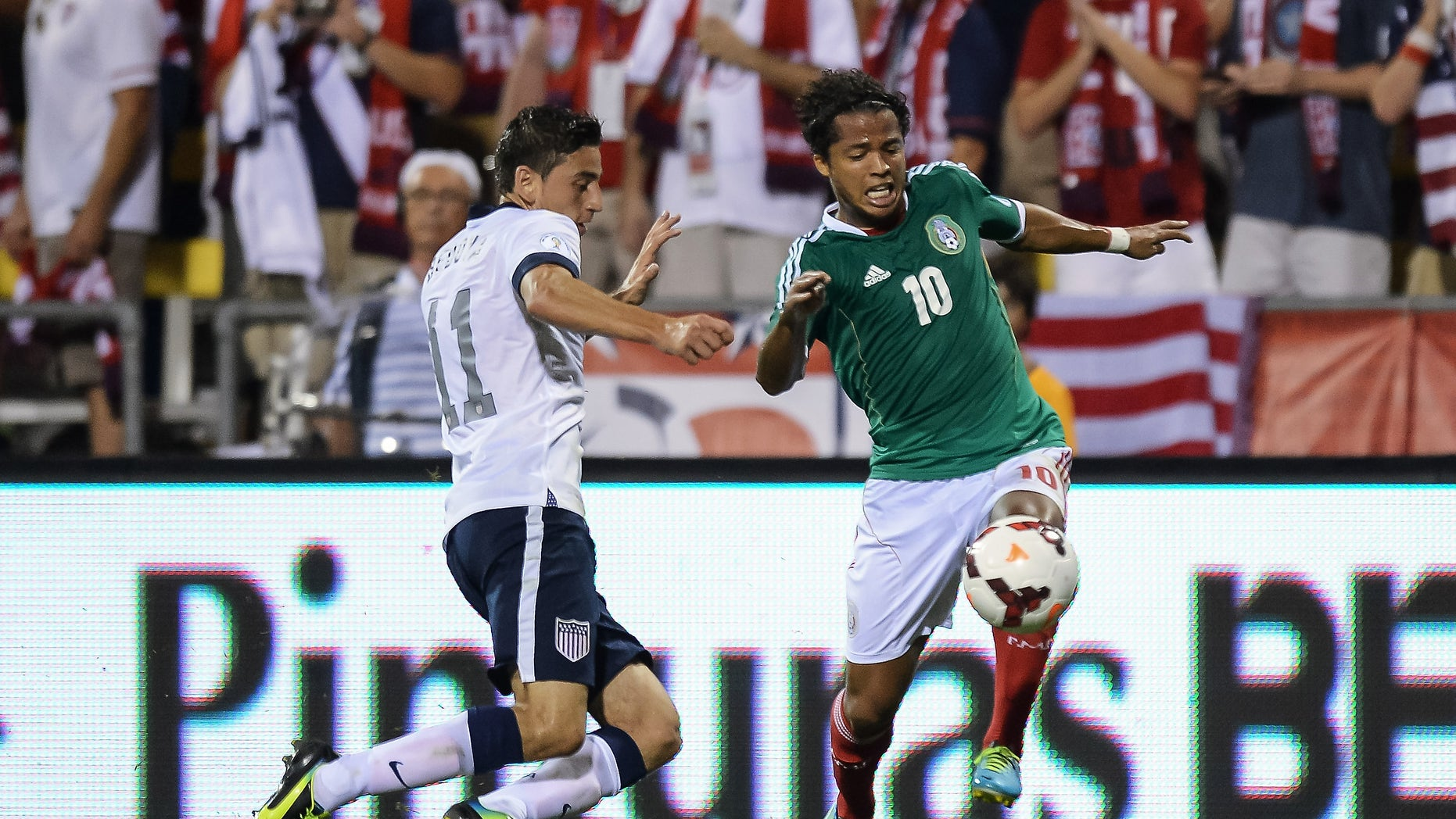Mexico's #10 Giovani dos Santos in action against the United States on September 10, 2013 in Columbus, Ohio.