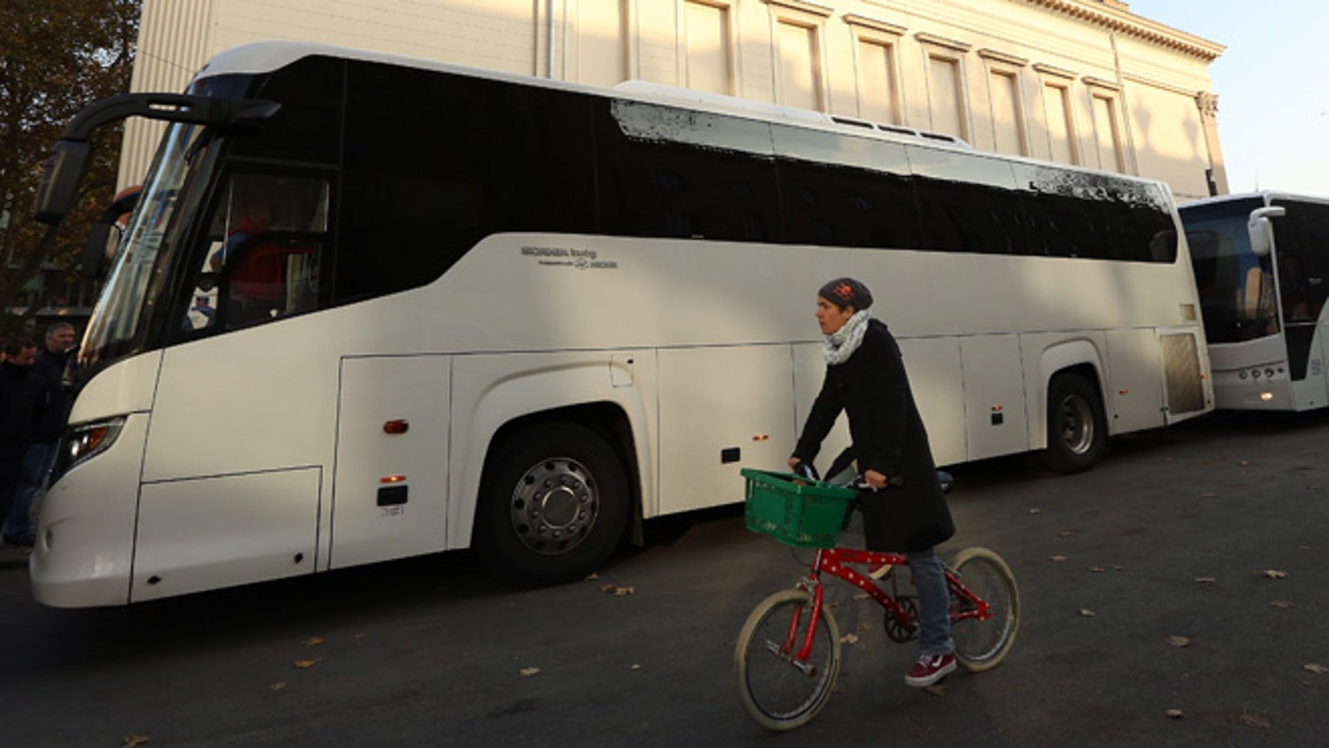 BERLIN, GERMANY - NOVEMBER 07: Two buses full of activists traveling from Berlin to the Mediterranean to 'Tear down the European Wall,' or cut down portions of the European Union's border fence, prepare to depart from outside the Gorki Theater on November 7, 2014 in Berlin, Germany. Amidst ongoing celebrations for the 25th anniversary of the Fall of the Berlin Wall, activists from the group Center for Political Beauty (CPB, or Zentrum fuer Politische Schoenheit, ZPS, in German) claim to have removed 14 white crosses from the city center placed in memory of some of the victims killed trying to cross from East to West Berlin during the Cold War, a protest designed to call attention to the activists' perceived hypocrisy found in fortifying the border preventing entry for refugees into Europe while celebrating the fall of the notorious one in Berlin a quarter of a century ago. The artist collective claims to have given the crosses to refugees from Mali hiding in the forests of Mount Gurugu in northern Morocco who are trying to cross into Melilla, one of two Spanish enclaves in the region, for passage into Europe.  (Photo by Adam Berry/Getty Images)