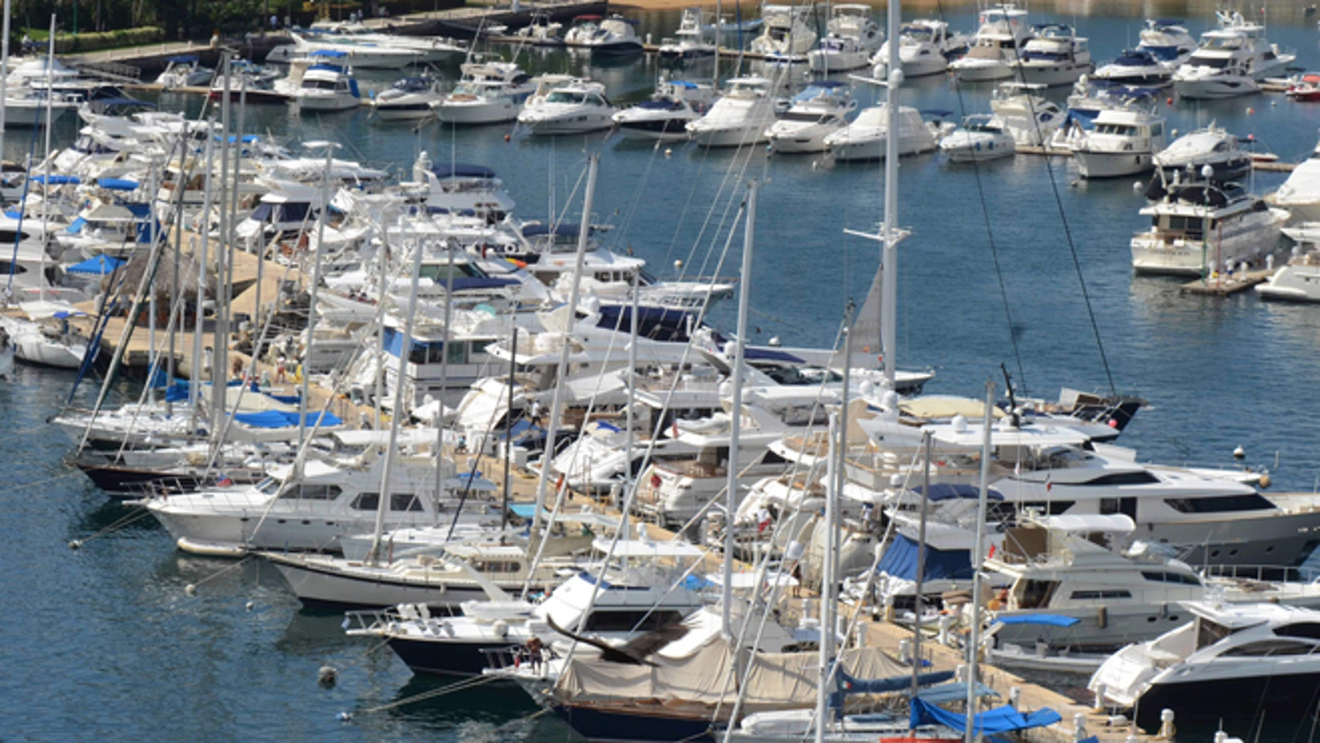 In this Tuesday,  Jan. 7, 2014 photo, yachts are docked at a marina in the Bay of Acapulco, Mexico. After inspecting more than 1,600 vessels in late November, the Mexican governmentâs Treasury Department announced it had initiated seizure orders against hundreds of foreign boats it accused of lacking a temporary import permit which proves that the holders own their boats and promise not to leave them in Mexico or sell them here. Many boat owners say they simply werenât around when authorities came by and slapped liens on the boats barring them from leaving Mexico, and say officials have not told them how they could remedy the situation.  Foreign pleasure boat owners call this a heavy-handed crackdown over a minor permit, and they say it threatens a tourism sector Mexico has long sought to promote. (AP Photo/Bernandino Hernandez)
