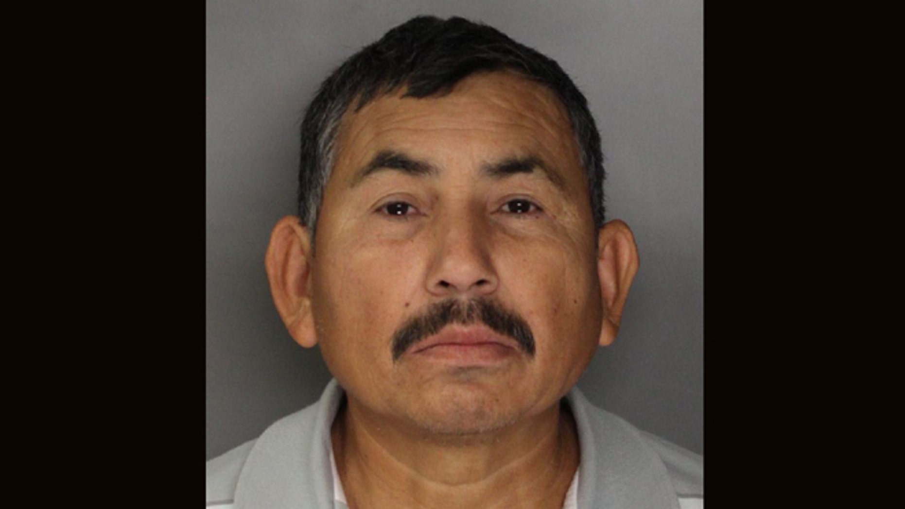 In this handout photo released by the Sacramento County Sheriff's Department is  Genaro Olaguez, who was arrested and sent back to Mexico on allegations that he killed eight government officials in Mexico.  Olaquez was arrested in Sacramento, Calif., Tuesday, Dec. 3, 2013, in connection with  the May 2, 2000, murders of a commissioner and seven other city officials in Sinaloa, Mexico.(AP Photo/Sacramento County Sheriff's Department)