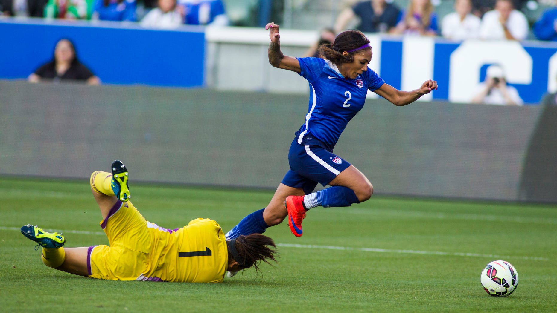 United Statesâ forward Sydney Leroux, right, dives the ball past Mexico's goalkeeper Cecilia Santiago to score the opening goal during the first half of their friendly soccer match, Sunday, May 17, 2015, at StubHub Center? in Carson, Calif. (AP Photo/Ringo H.W. Chiu)