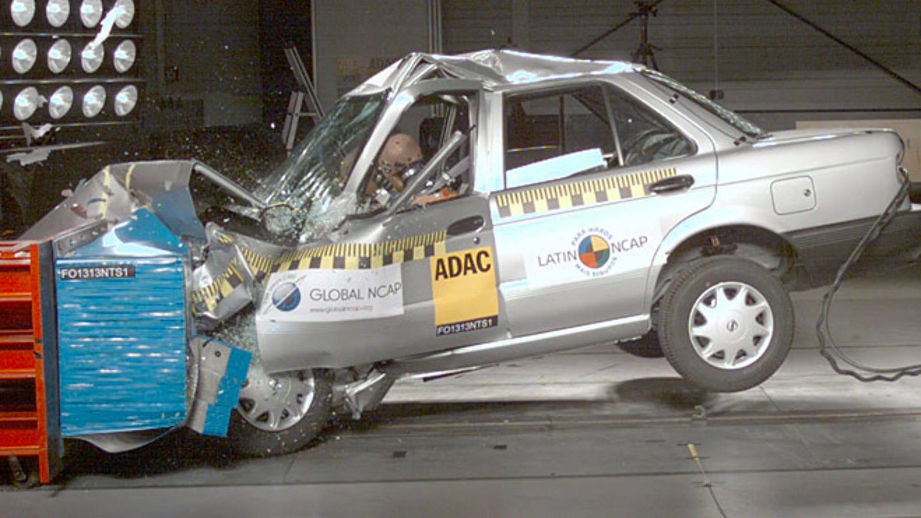 In this image taken from a March 2013 video released by independent crash-test group Latin NCAP on Nov. 27, 2013, a Nissan model Tsuru vehicle with no airbags is crash-tested at Latin NCAP's facilities in Landsberg am Lech, Germany.VMany international car manufacturers with plants in Mexico produce two versions of cars; sending models with air bags, antilock brakes and electronic stability control to the United States, and cars without those safety features to the local market. (AP Photo/Latin NCAP)