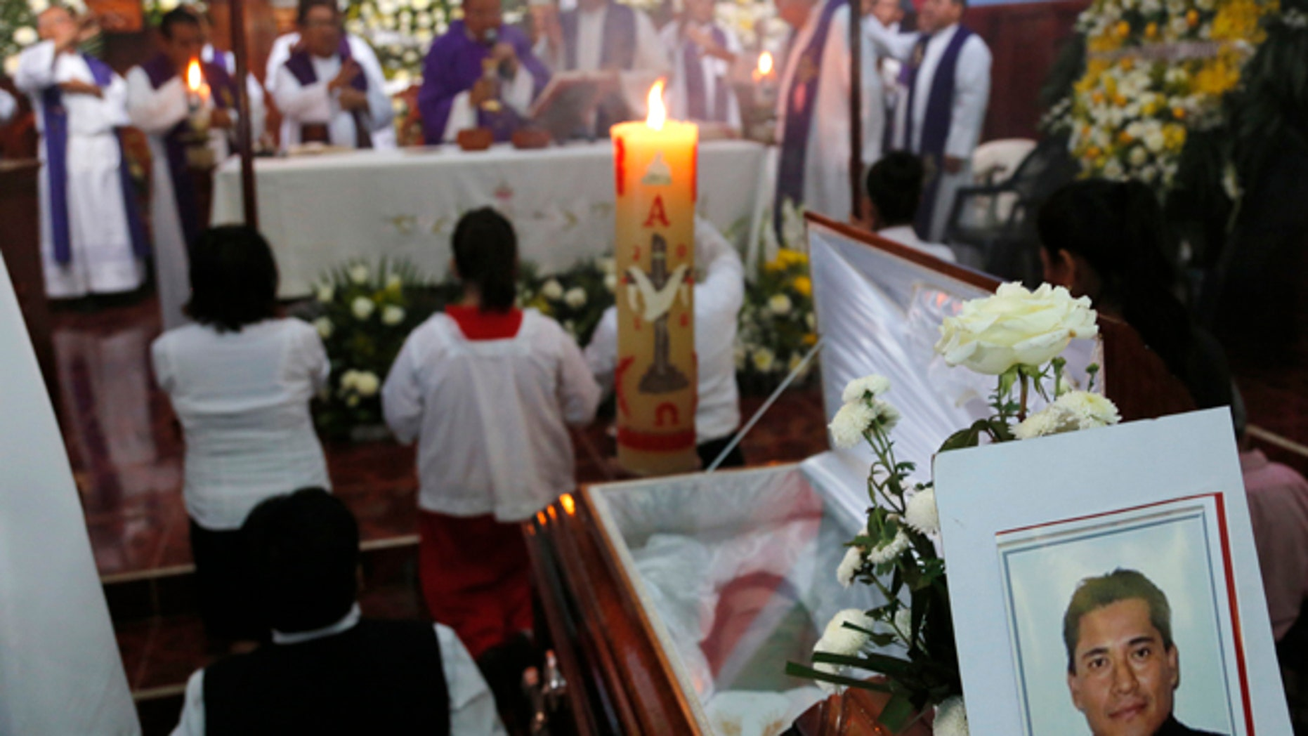 This Sept. 21, 2016 photo shows the funeral Mass for slain Rev. Jose Alfredo Suarez de la Cruz at Our Lady of Asuncion Church in Paso Blanco, Veracruz state, Mexico, his hometown. Church leaders are increasingly frustrated by authoritiesââ¬â¢ inability to protect their priests under Mexican President Enrique Pena Nietoââ¬â¢s administration. (AP Photo/Marco Ugarte)