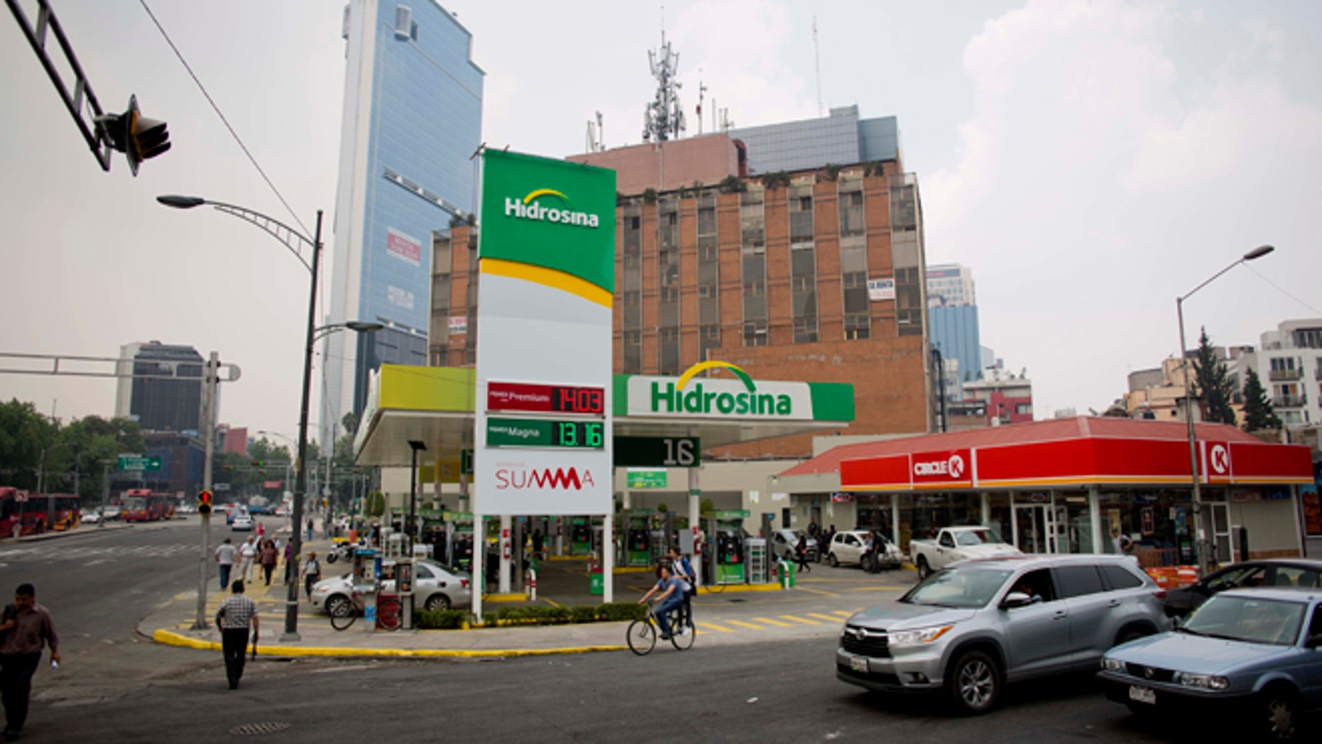 Hidrosina opened a re-branded Pemex gas station on one of the main avenues in Mexico City, Tuesday, June 7, 2016.  Mexico's ubiquitous Pemex gas stations now have competition along the country's highways and city streets for the first time in nearly eight decades. Two companies have collectively opened three gas stations under their own brands, breaking one of the state-owned petroleum company's last monopolies. Opening the retail sector to competition was part of energy reforms passed in 2014. (AP Photo/Eduardo Verdugo)