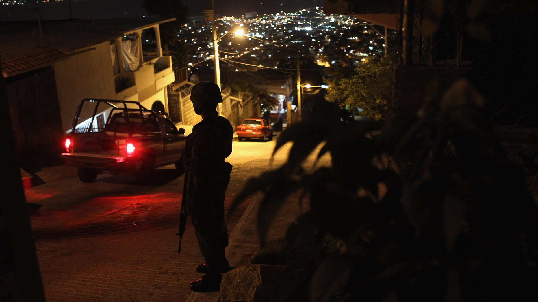 A Mexican army soldier stands guard at a suspected drug-related murder site  March 3, 2012 in Acapulco, Mexico.  (Photo by John Moore/Getty Images)