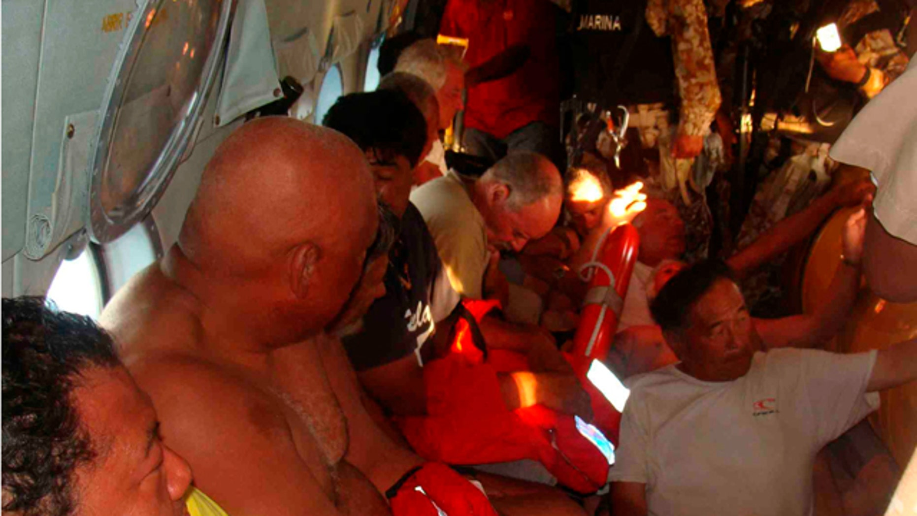 July 4: Survivors of a capsized boat inside a helicopter after being rescued by the Navy in the town of San Felipe.