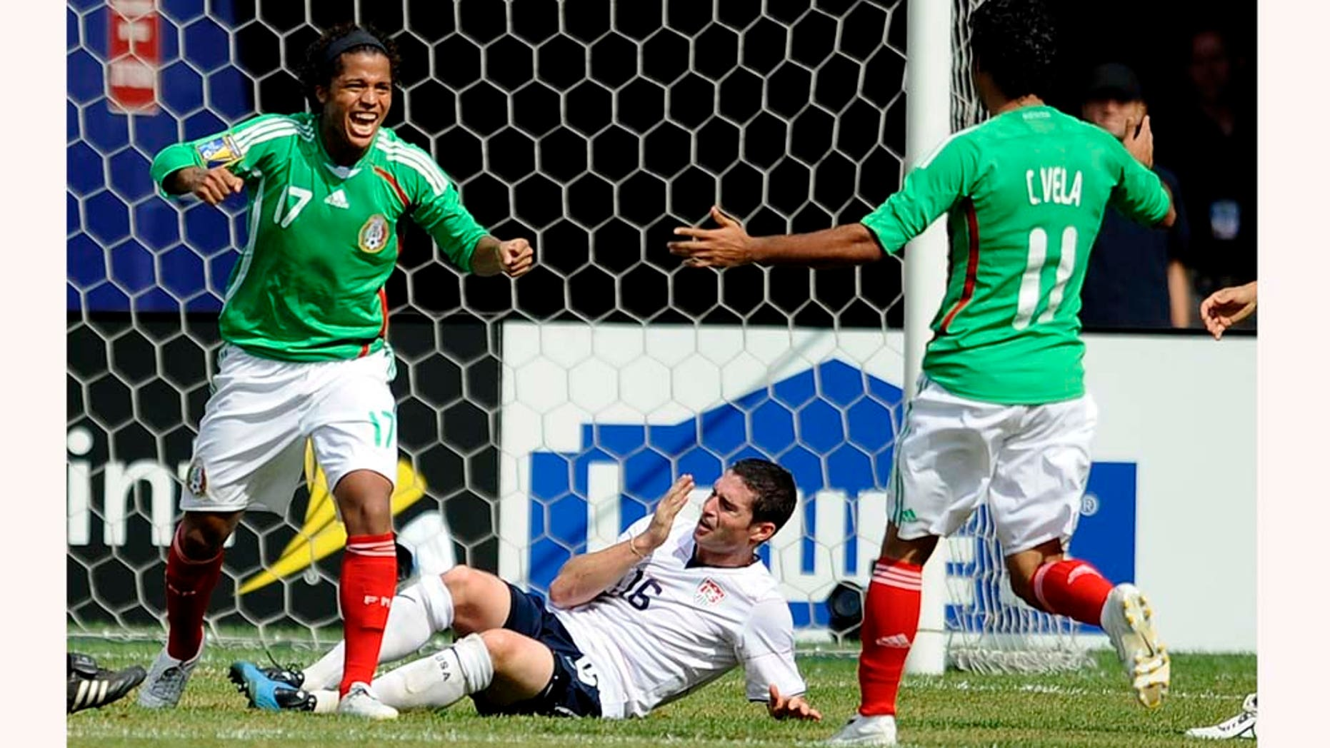 EAST RUTHERFORD, NJ - JULY 26:  Giovani Dos Santos #17 and Carlos Vela #11 of Mexico celebrate Dos Santos' goal in front of Jay Heaps #16 of the United States in the CONCACAF Gold Cup Championship match at Giants Stadium on July 26, 2009 in East Rutherford, New Jersey.  (Photo by Jeff Zelevansky/Getty Images)