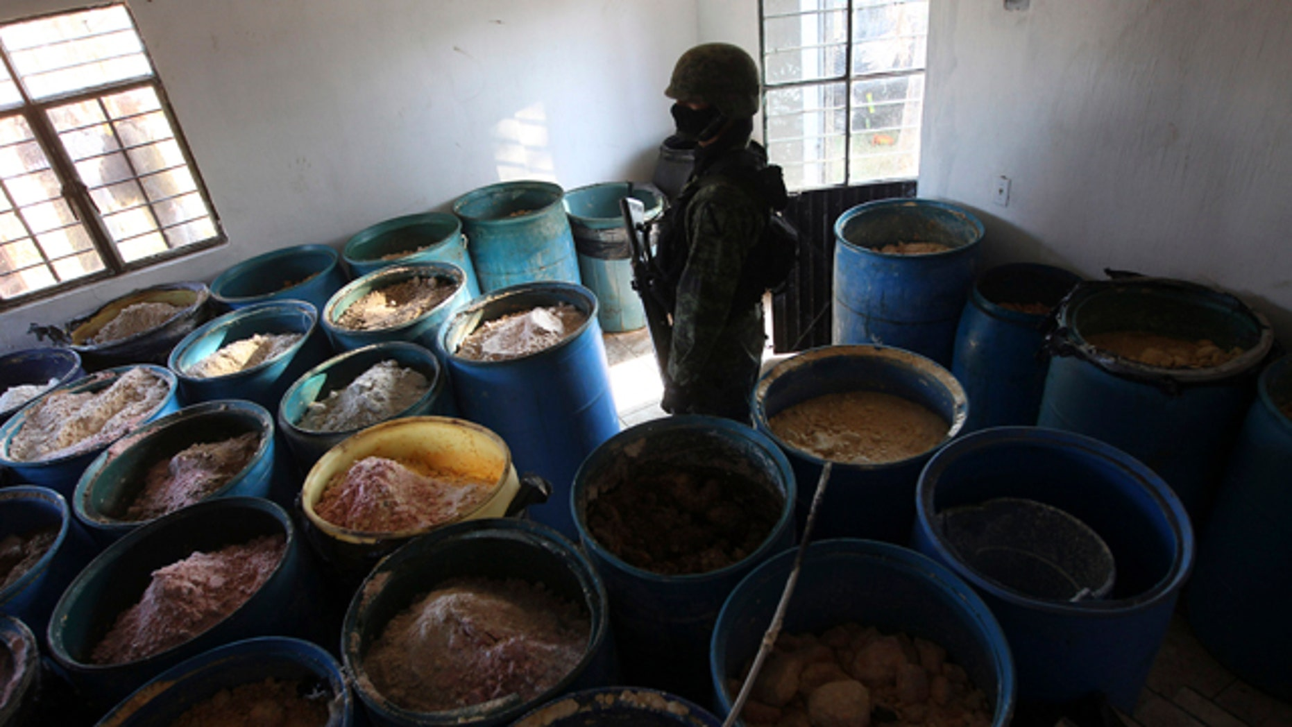 Feb. 9, 2012- A soldier stands in a room full of barrels containing white and yellow powder after a seizure of a small ranch in Tlajomulco de Zuniga, on the outskirts of Guadalajara, Mexico. According to the Mexican army, 15 tons of pure methamphetamine were seized at the ranch, an amount equivalent to half of all meth seizures worldwide in 2009.