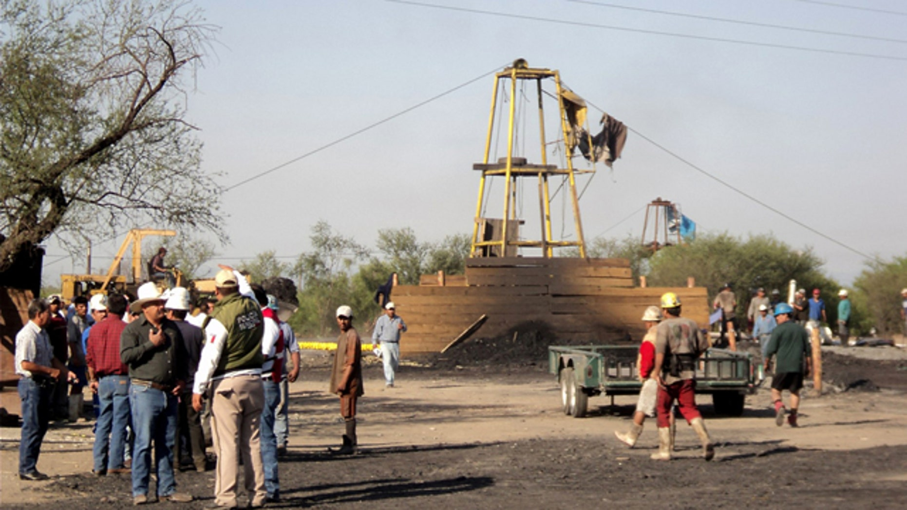 May 3: People wait outside a coal mine in San Juan de Sabinas, in the Mexican state of Coahuila.