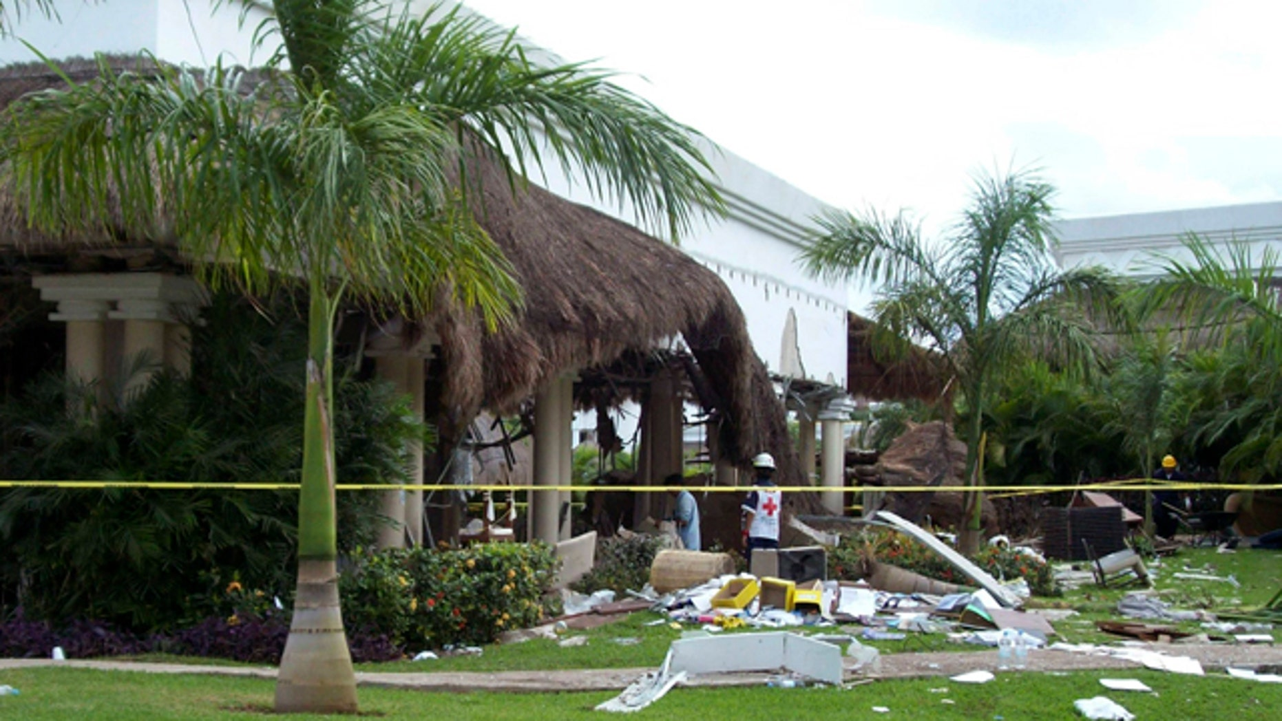 Nov. 14, 2010: Red Cross volunteer watches to the inside of the Grand Riviera Princess Hotel in Playa del Carmen, Quintana Roo state, Mexico.