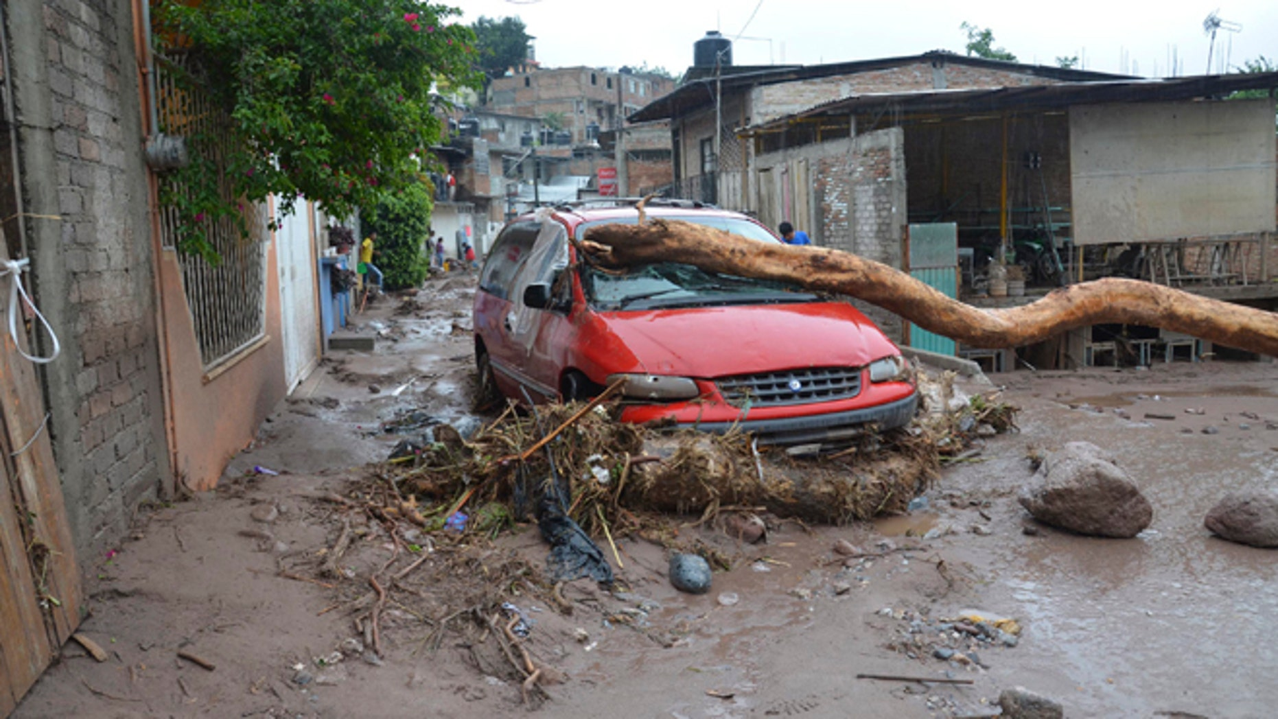 Sept. 16, 2013: A damaged vehicle stands in the middle of a road after a landslide caused by heavy rains came down on a low income neighborhood in the city of Chilpancingo, Mexico.