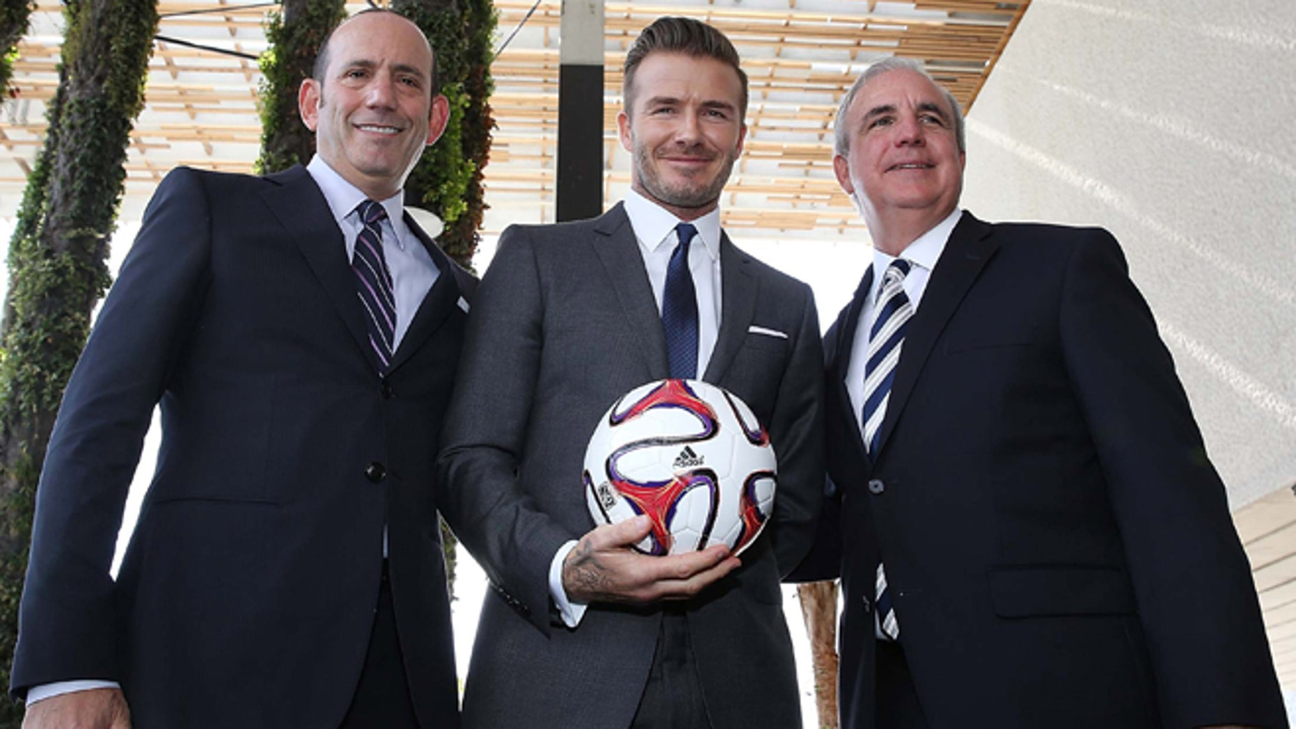 MLS Commissioner Don Garber, David Beckham and Miami-Dade County Mayor Carlos Gimenez at a press conference announcing the new pro soccer franchise on February 5, 2014 in Miami, Florida. (Photo by Aaron Davidson/Getty Images)