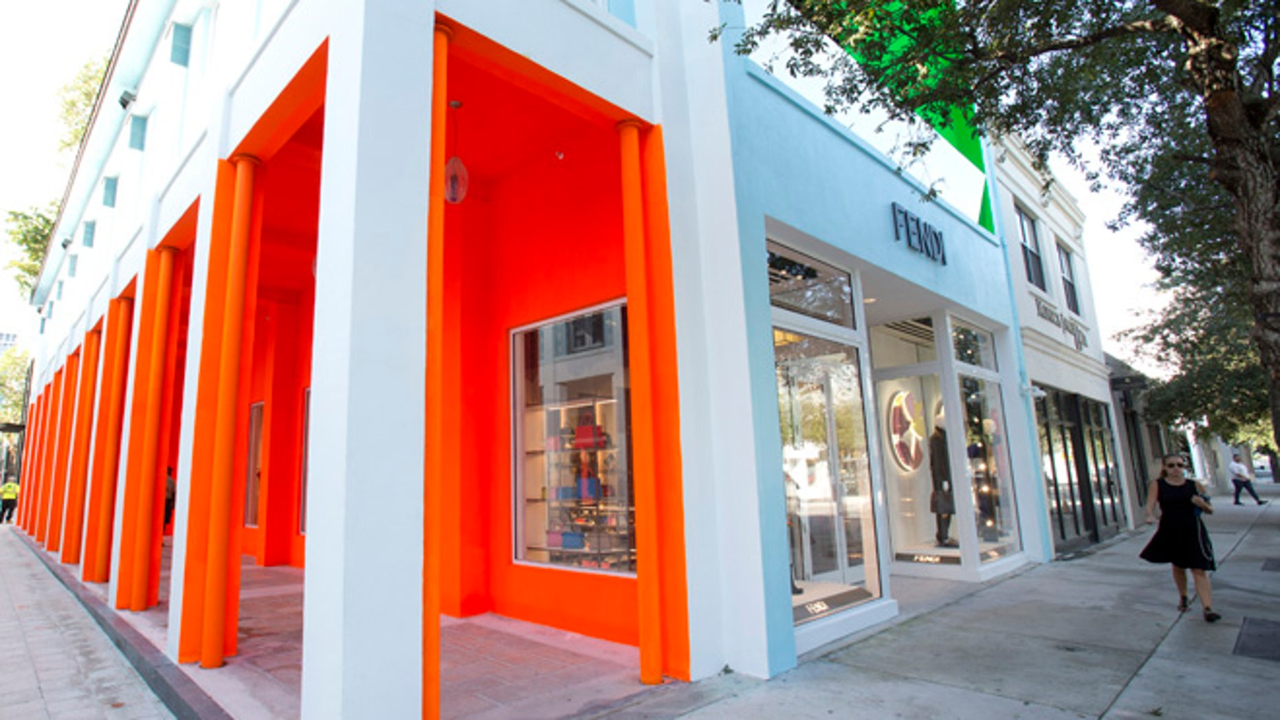 FILE - In this Oct. 30, 2015, file photo, a pedestrian walks past a Fendi store in the Miami Design District in Miami. A proliferation of luxury stores in Miami is serving wealthy Latin Americans fleeing financial and political turmoil in their countries. (AP Photo/Wilfredo Lee, File)
