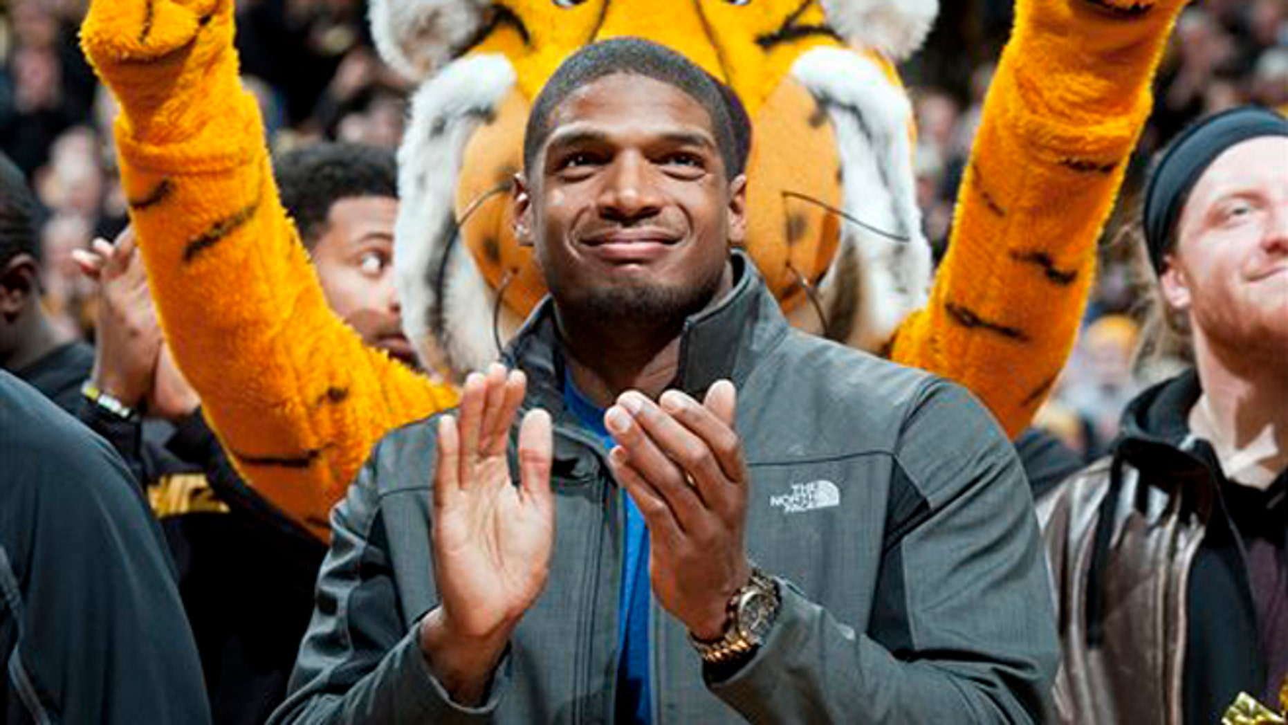 Michael Sam at halftime of an NCAA college basketball game on Feb. 15, 2014.