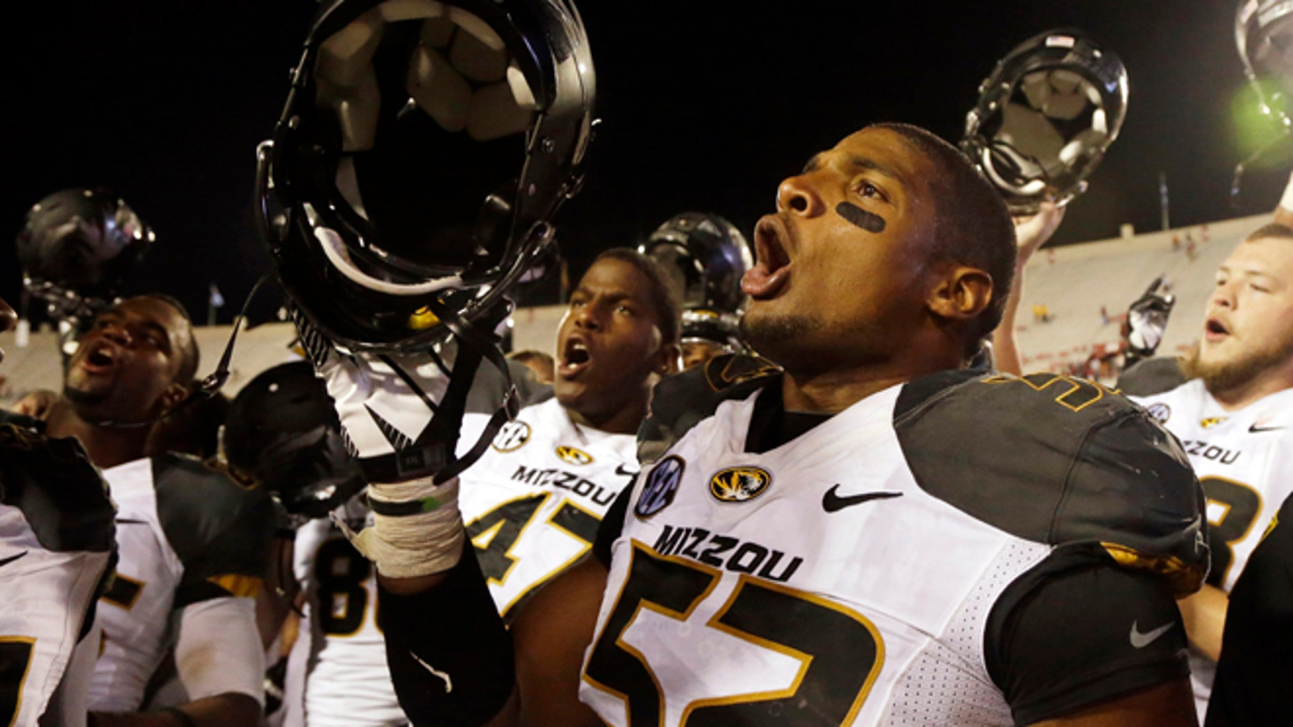 FILE - In this Sept. 21, 2013, file photo, Missouri's Michael Sam (52) sings the school song after Missouri defeated Indiana in an NCAA college football game in Bloomington, Ind. The All-American athlete says he is gay, and the defensive end could become the first openly homosexual player in the NFL. (AP Photo/Darron Cummings, File)
