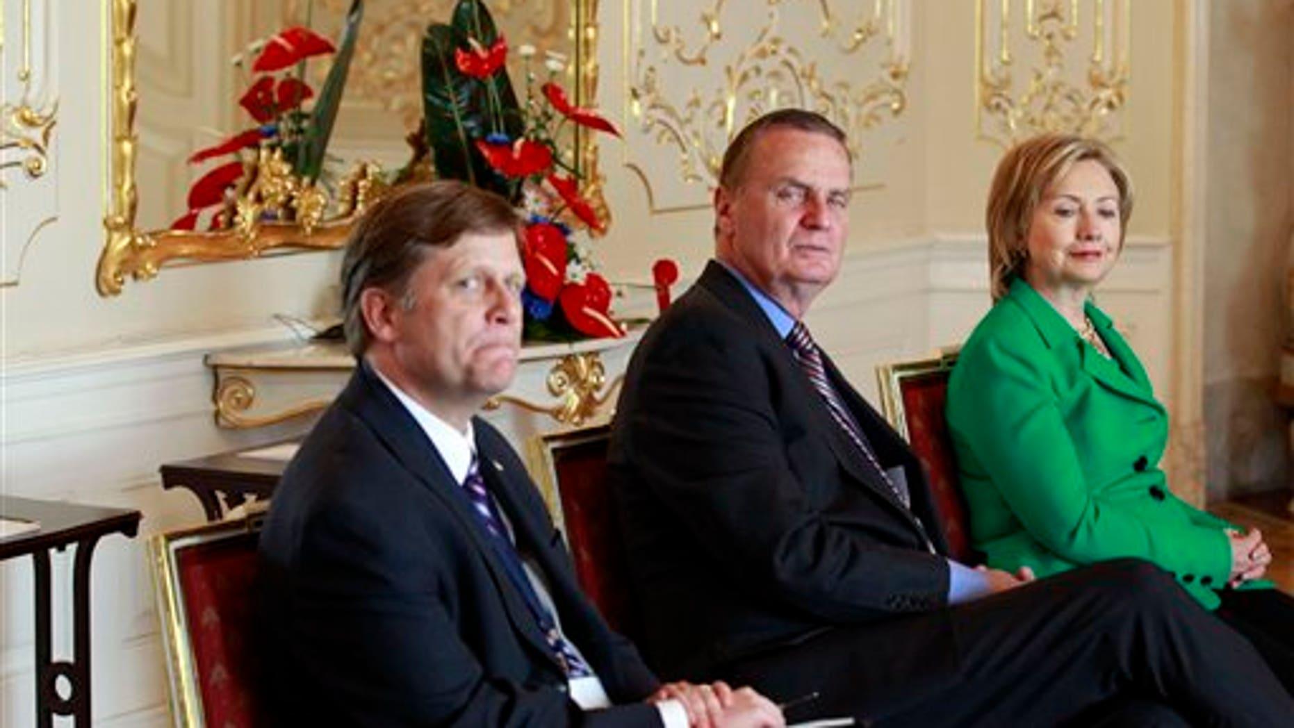 AP Photo; April 8, 2010; McFaul on left