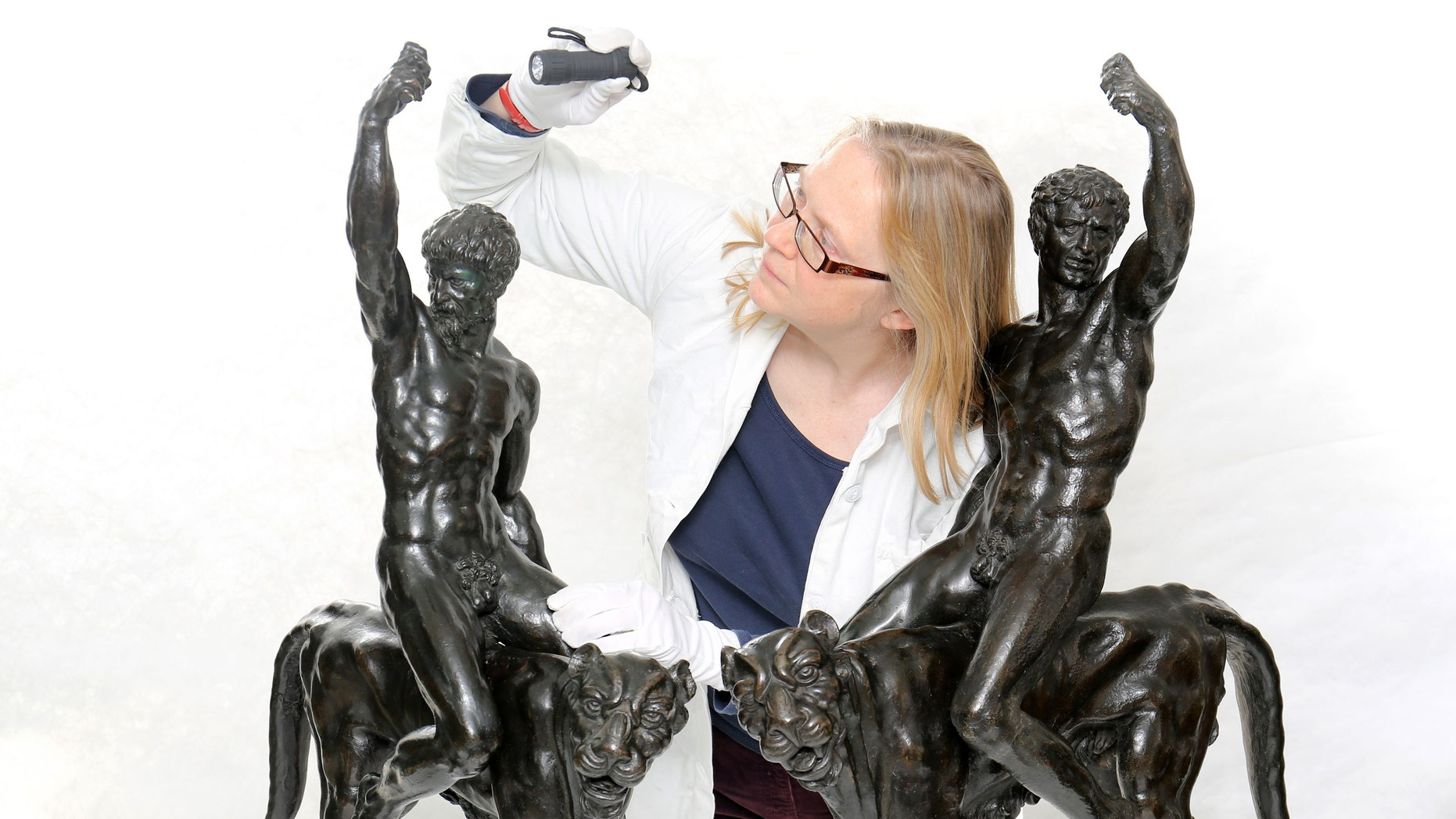 Dr Victoria Avery, keeper of applied arts at the Fitzwilliam Museum at the University of Cambrdige examines two bronze sculptures thought to be works by Michelangelo.