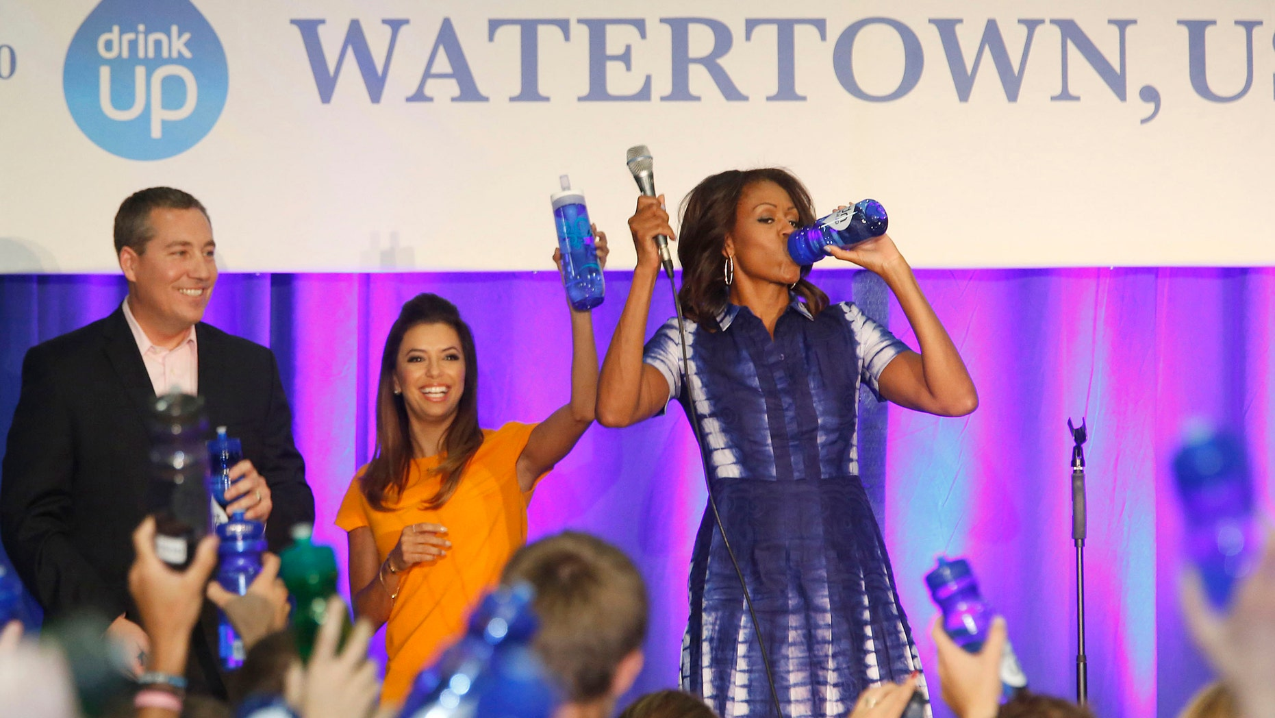 """Actress Eva Longoria teams with Brita to join First Lady Michelle Obama and Watertown High School principal Scott Mantei in support of """"Drink Up,"""" a new effort launched by the Partnership for a Healthier America in Watertown, Wis."""