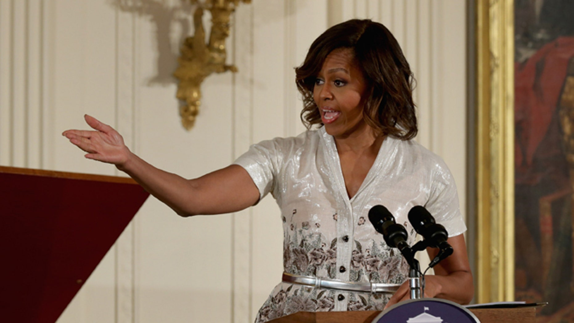 WASHINGTON, DC - MAY 12:  First lady Michelle Obama delivers remarks during the annual Mother's Day tea to honor military mothers at the White House May 12, 2014 in Washington, DC. Part of the Joining Forces initiative, Obama and Dr. Jill Biden also helped military kids create Mother's Day cards and homemade gifts, which the children presented to their mothers and grandmothers.  (Photo by Chip Somodevilla/Getty Images)