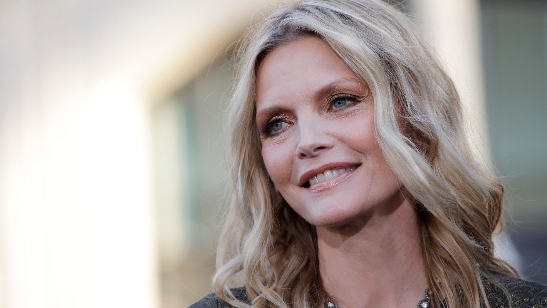 """Cast member Michelle Pfeiffer poses at the premiere of the film """"Dark Shadows"""" at the Grauman's Chinese theatre in Hollywood, California May 7, 2012."""