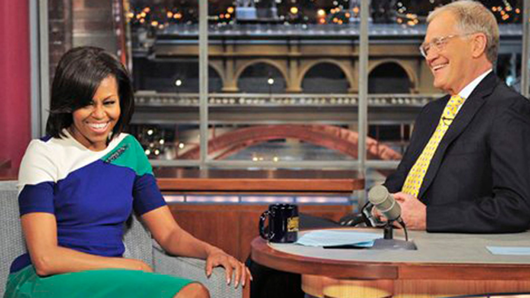 Mar. 19, 2012: In this photo provided by CBS, first lady Michelle Obama joins host David Letterman on the set of the Late Show with David Letterman.