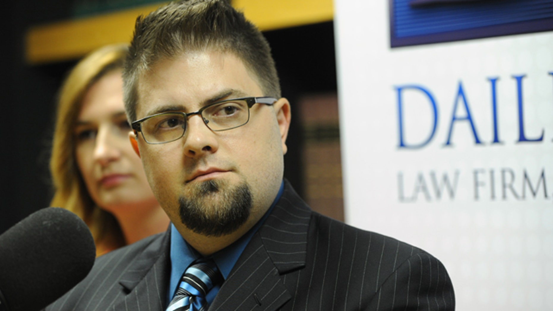 Aug. 17, 2015: Joshua Cline, former aide to Michigan state Reps. Todd Courser and Cindy Gamrat, talks about the scandal engulfing them during a news conference at Dailey Law Firm , P.C. in Royal Oak, Mich. (Brandy Baker / The Detroit News via AP)