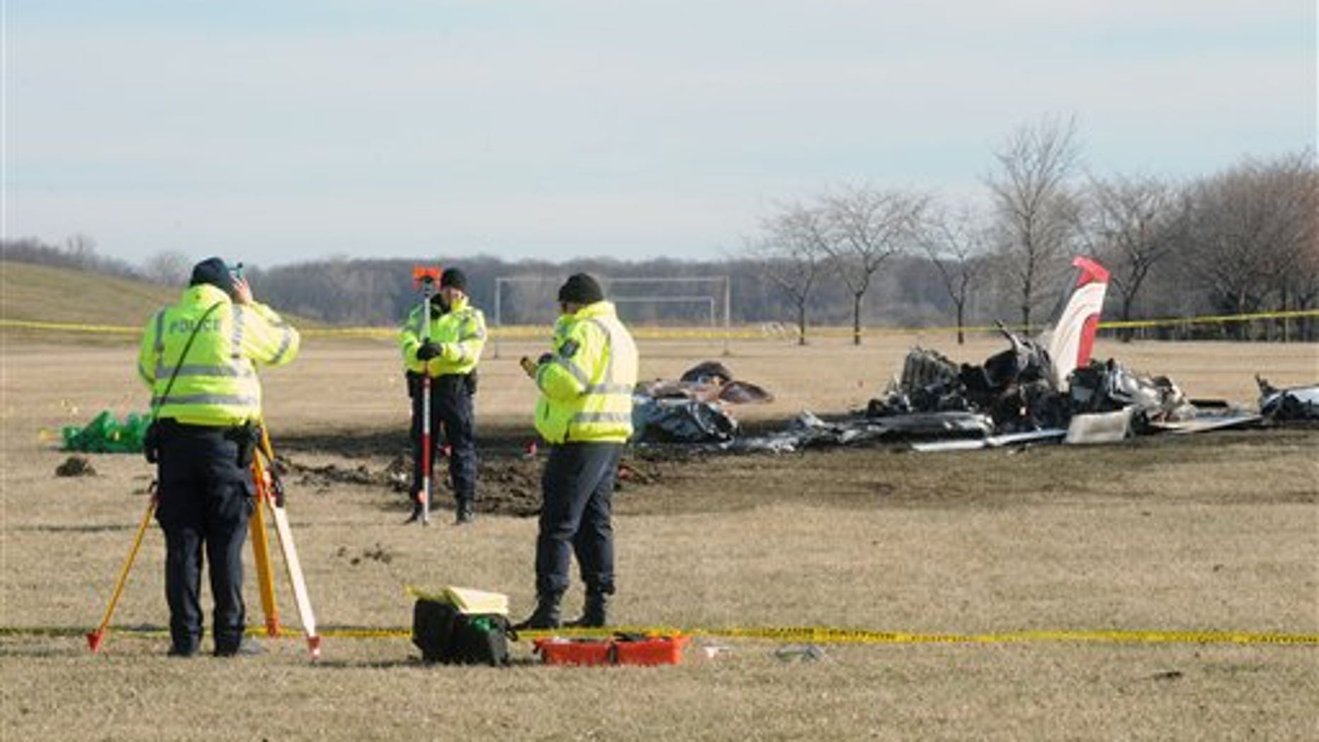 March 30: Monroe City Police take measurements while investigating the site of a small plane crash in Monroe, Michigan.