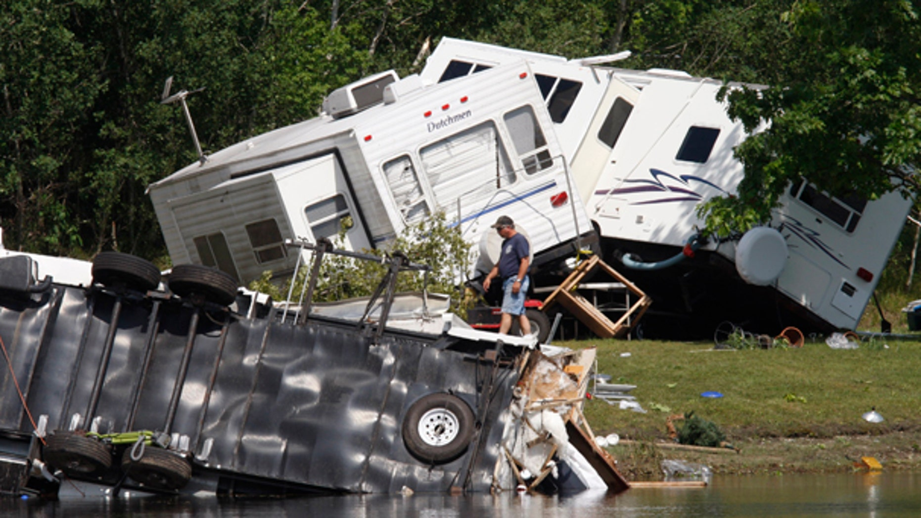 June 28: Overturned trailers are shown at the Fort Trodd Family Campground in Clyde Township, Mich. (AP)