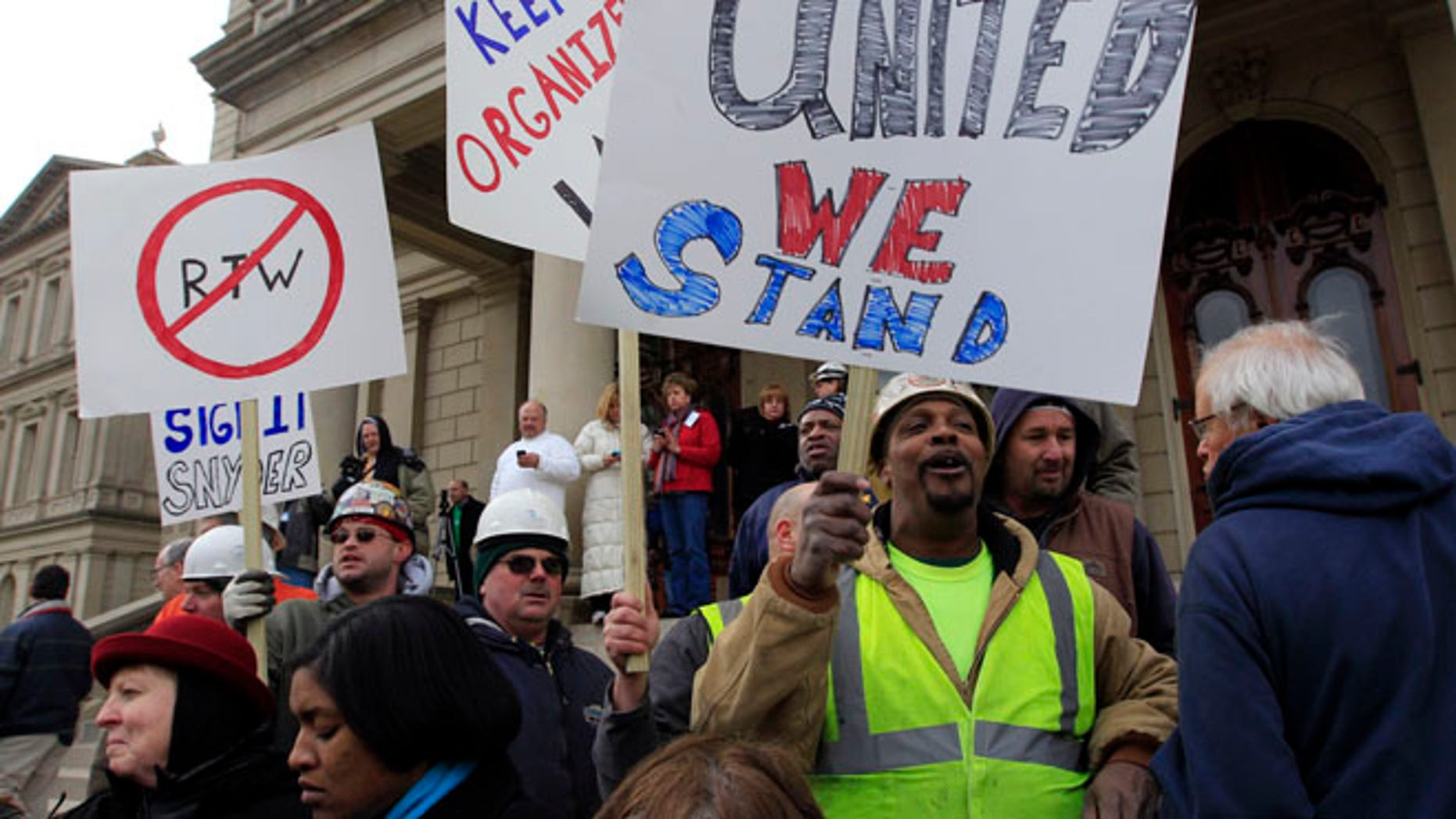 Dec. 6, 2012: Union workers rally outside the Capitol in Lansing, Mich., as Senate Republicans introduced right-to-work legislation in the waning days of the legislative session.