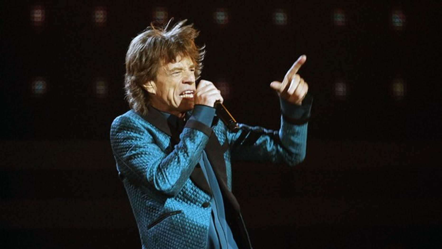 """Mick Jagger performs """"Everybody Needs Someone to Love"""" at the 53rd annual Grammy Awards in Los Angeles, California February 13, 2011."""
