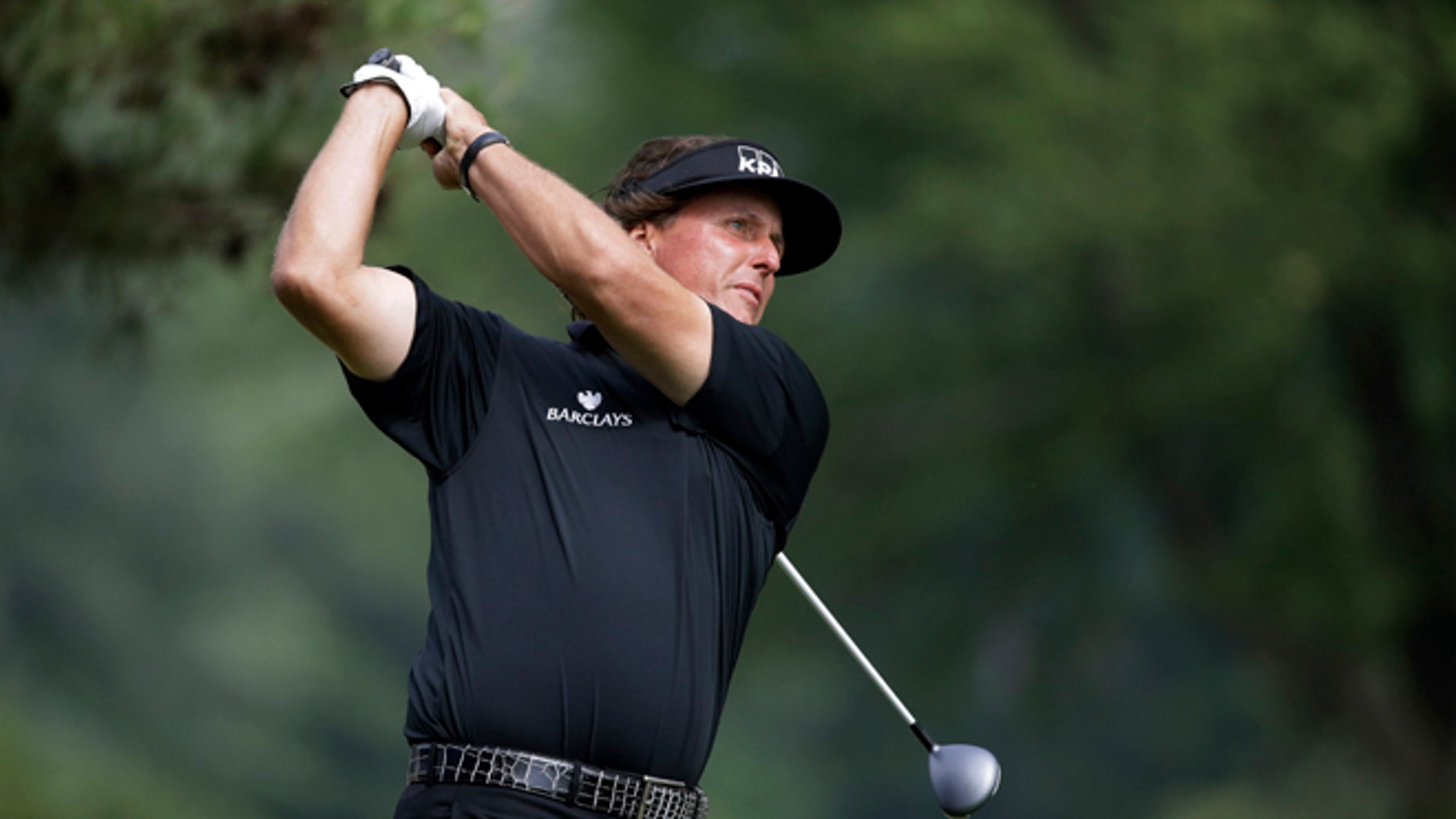 June 16, 2013: Phil Mickelson tees off on the second hole during the fourth round of the U.S. Open golf tournament at Merion Golf Club in Ardmore, Pa.