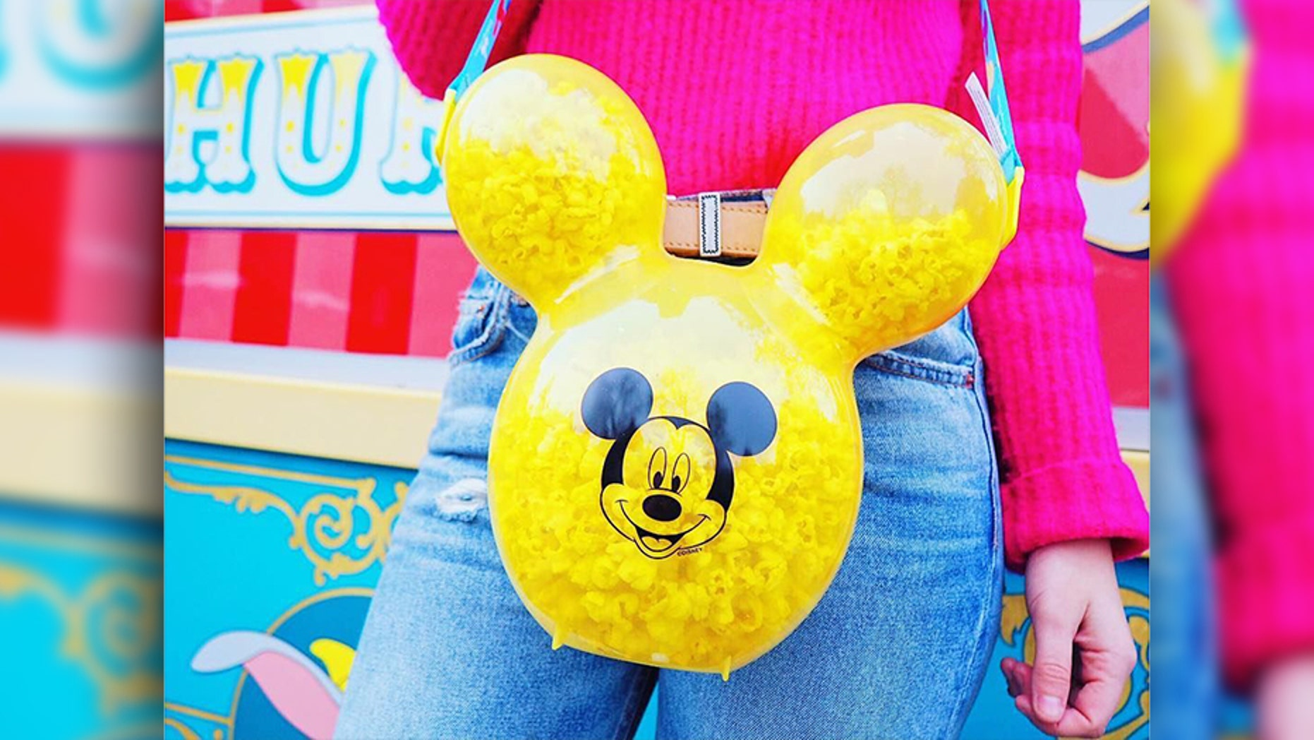 The latest craze at Disneyland isn't a flavored churro or seasonal treat, but a playful accessory intended to hold the timeless salty snack.