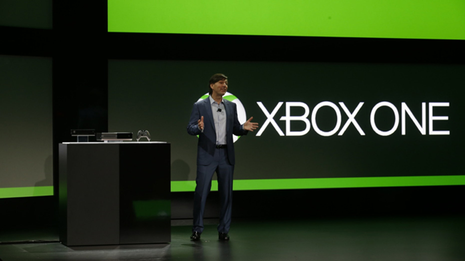 File photo - May 21, 2013: Microsoft's Don Mattrick unveils the next-generation Xbox entertainment and gaming console system at an event in Redmond, Wash. It's been eight years since the launch of the Xbox 360. (AP Photo/Ted S. Warren)