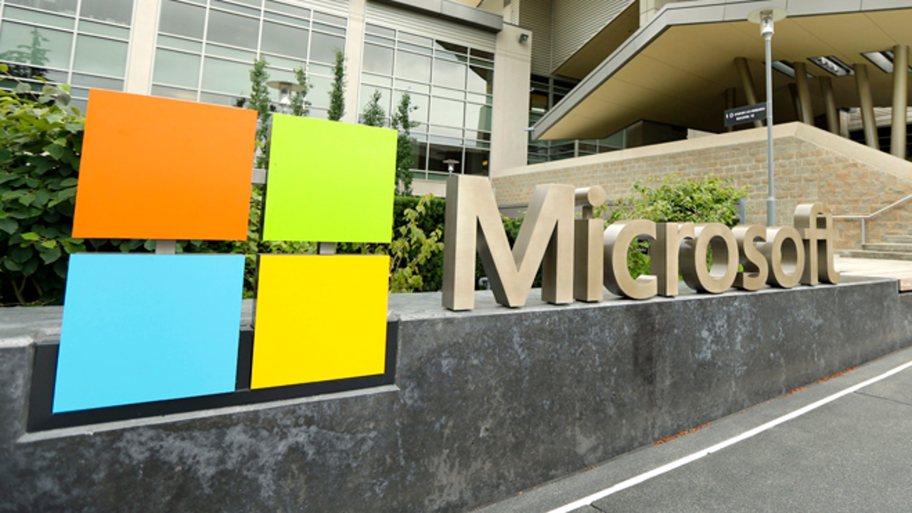 File photo - This July 3, 2014 photo shows Microsoft Corp. signage outside the Microsoft Visitor Center in Redmond, Wash. Microsoft on Thursday, July 17, 2014.