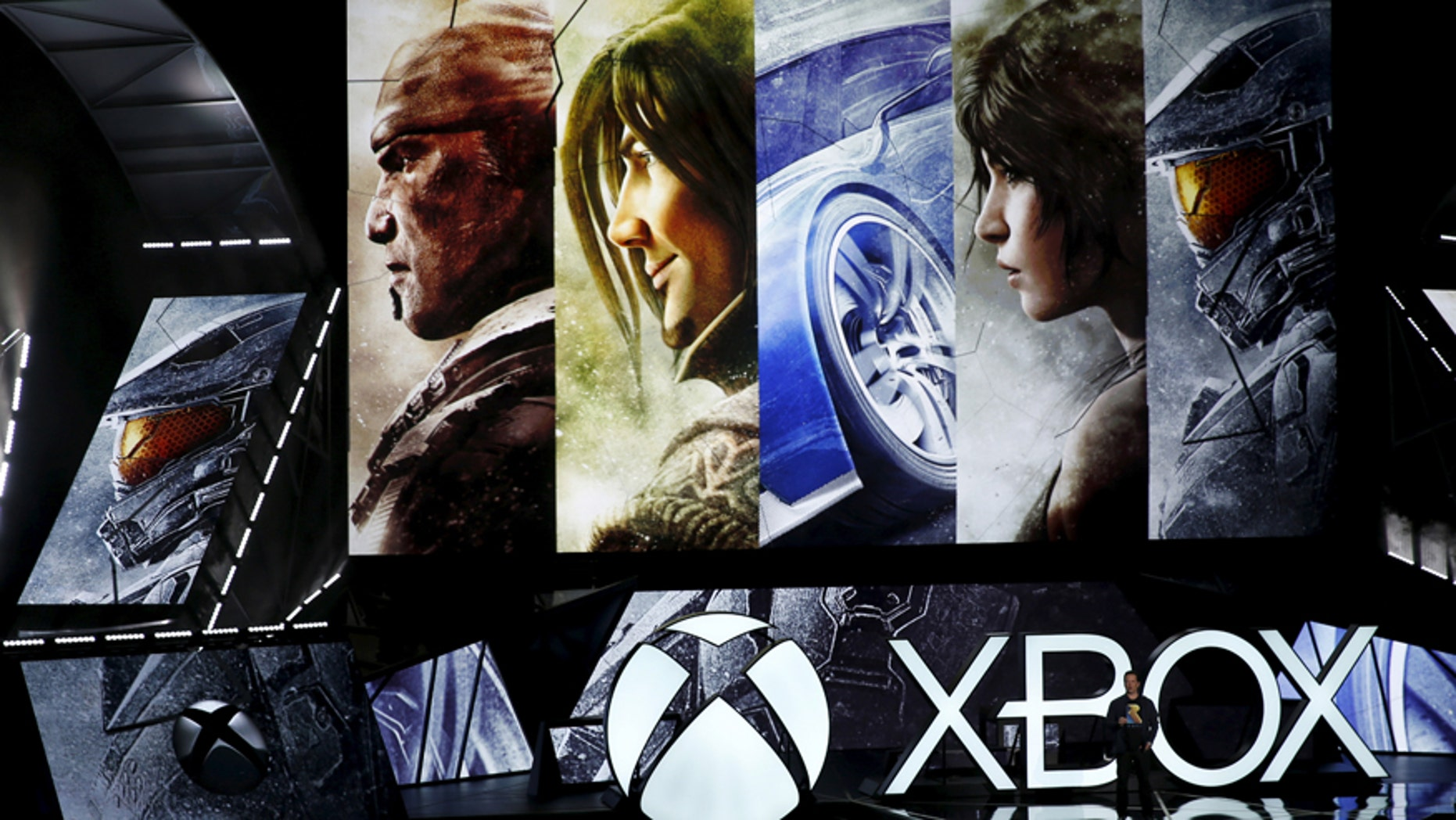 Phil Spencer, head of Xbox, talks about backwards compatibility to play all Xbox 360 games on the Xbox One during game publisher Microsoft's Xbox media briefing before the opening day of E3, in Los Angeles, Calif, June 15, 2015.
