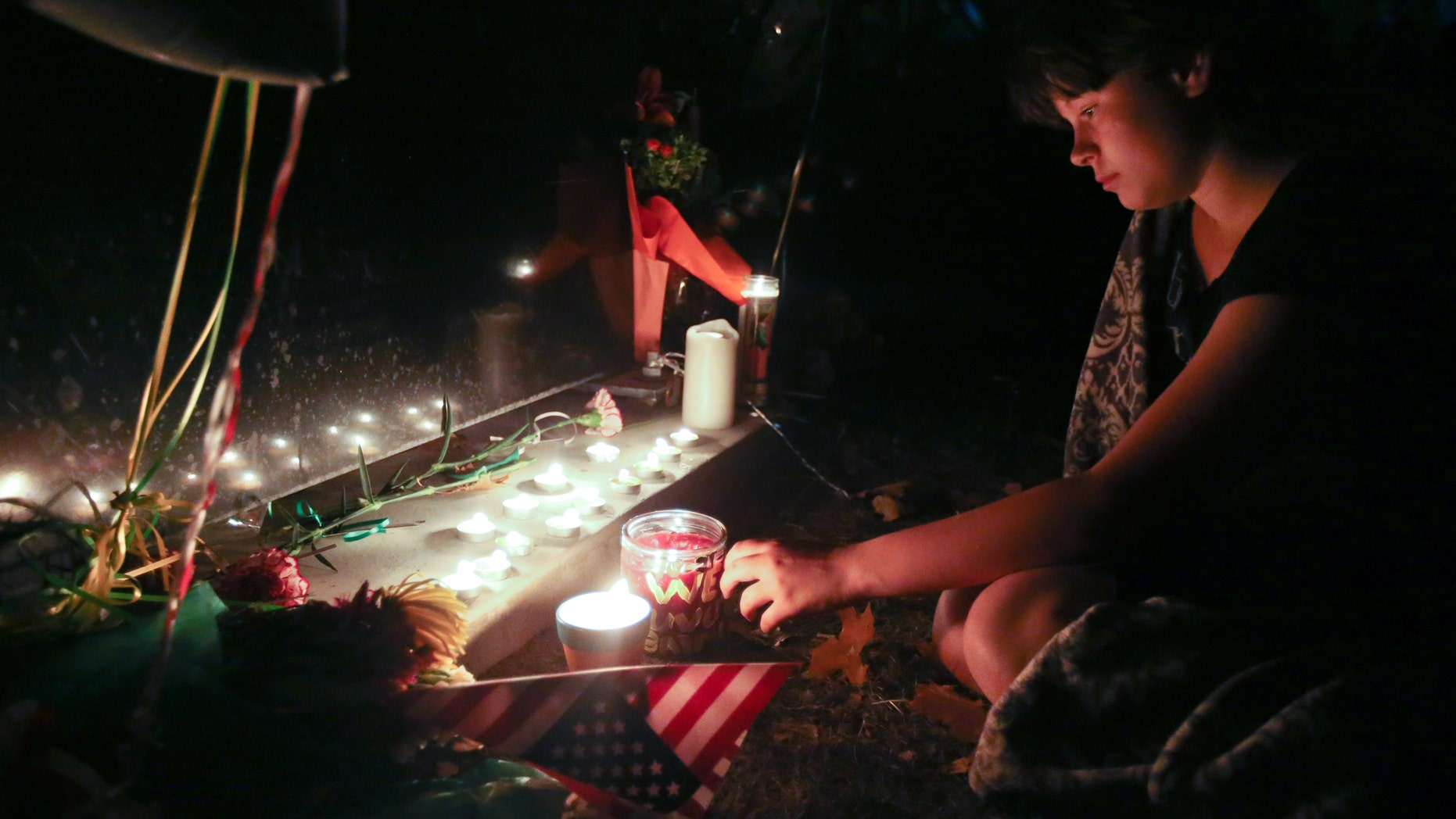 Oct. 23, 2013: Heaven Coker, 12, attends a candlelight vigil at Sparks Middle School in Sparks, Nev., in honor of slain teacher Michael Landsberry and two 12-year-old students who were injured after a fellow student open fire at the school on Monday, before turning the gun on himself.