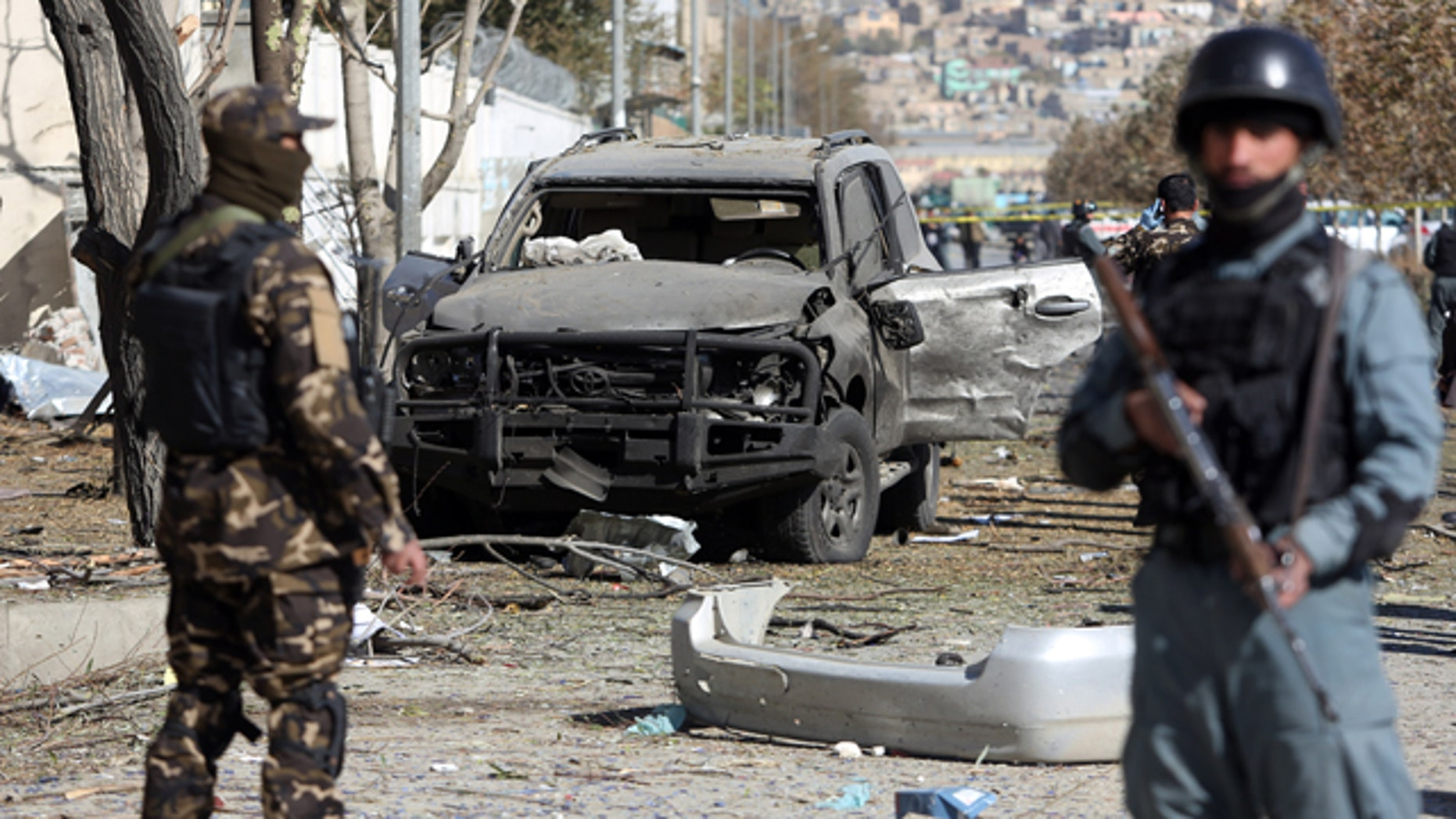 November 16, 2014: Afghan security forces inspect the site of a suicide attack in Kabul. A suicide bomber tried to assassinate a prominent female member of Afghanistan's parliament on Sunday, killing three people and wounding the lawmaker, a senior official said. (AP Photo/Rahmat Gul)