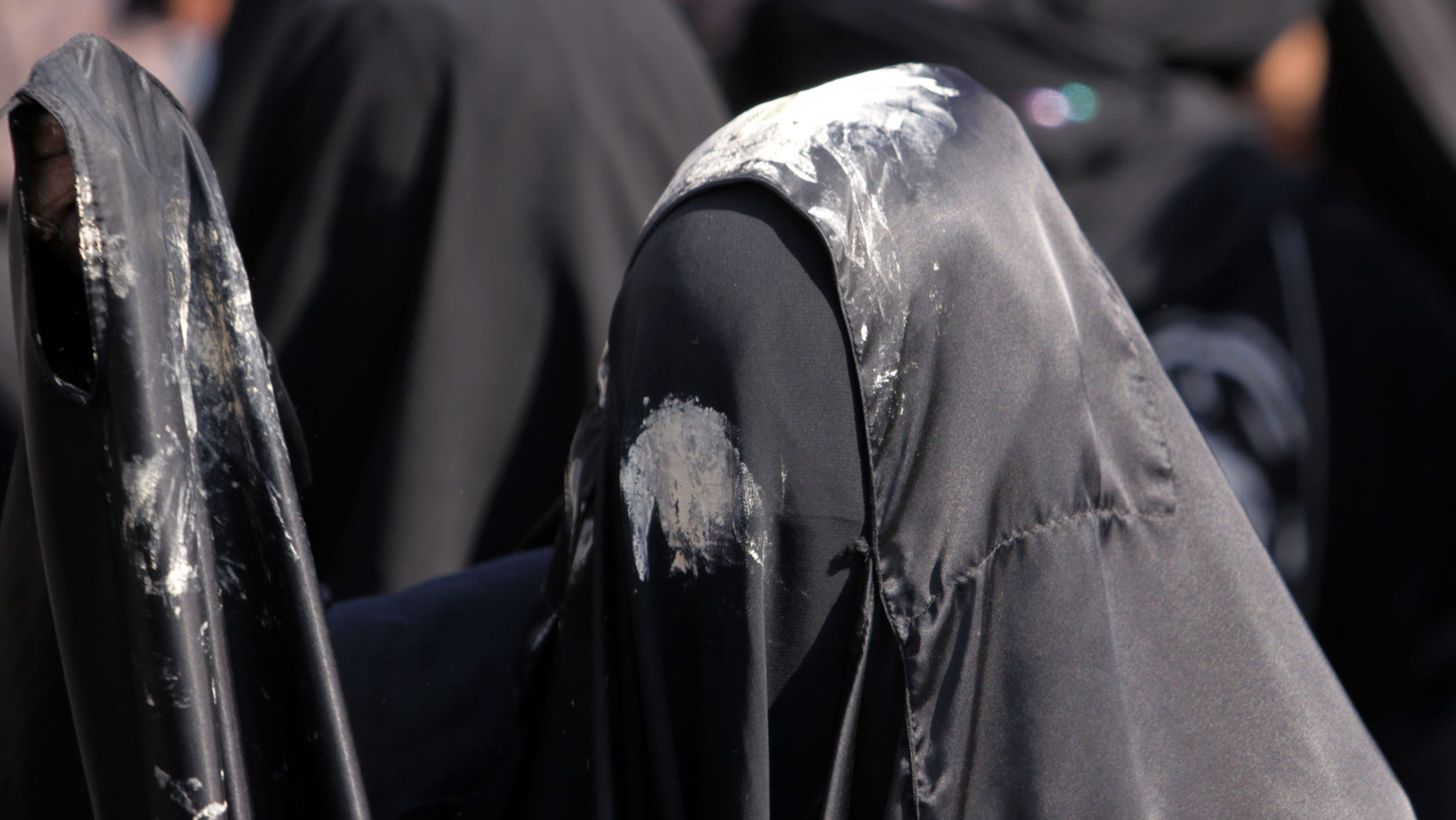 Dec. 6, 2011: A woman participates during a Shiite procession marking Ashura, a period of mourning for Imam Hussein, grandson of Islam's founding prophet Mohamed.