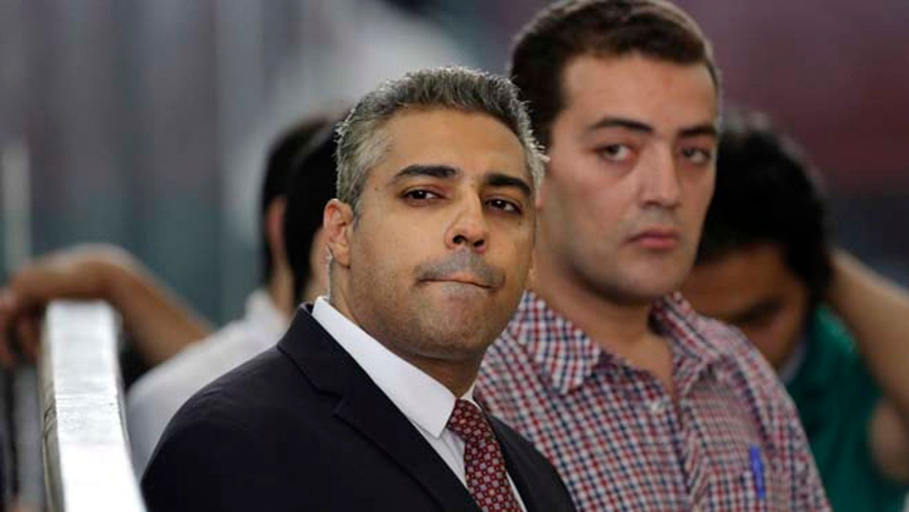 June 4, 2015: Canadian Al-Jazeera English journalist Mohammed Fahmy, left, and his Egyptian colleague Baher Mohammed listen in a courtroom in Tora prison in Cairo, Egypt.