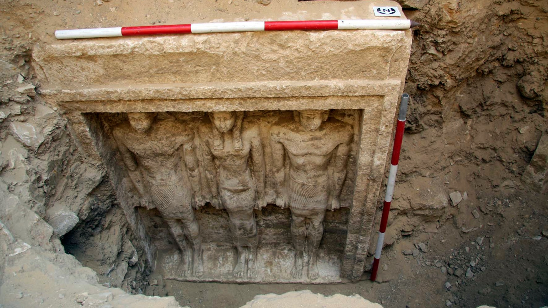 Oct. 11, 2012: This photo released Friday, Nov. 2, 2012 by Egypt's Supreme Council of Antiquities, shows recently discovered statues of two men and a woman in a complex of tombs, including one of a pharaonic princess, in the Abusir region, south of Cairo, Egypt.