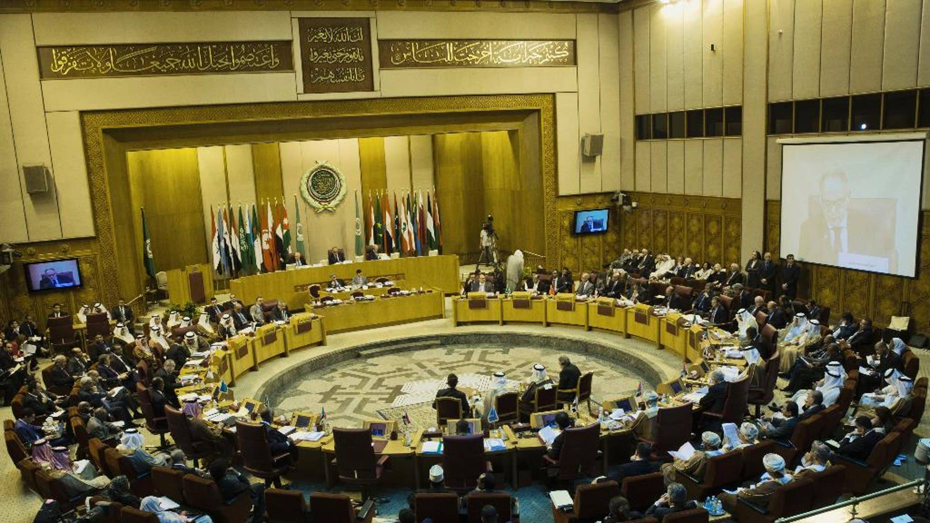 Arab foreign ministers take their seats for their meeting at the Arab League headquarters in Cairo, Egypt, Sunday, Sept. 7, 2014. Abbas, who has threatened to dissolve a new unity government if the Hamas militant group does not yield power in the Gaza Strip, attended the meeting in Cairo on Sunday. (AP Photo/Hassan Ammar)