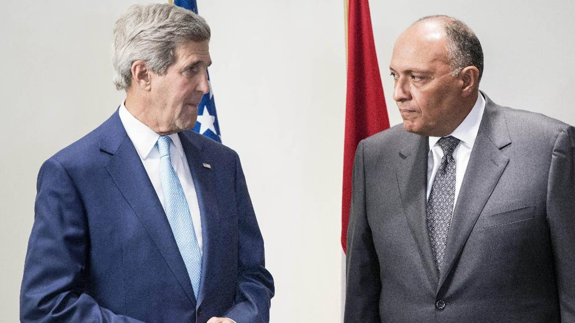 U.S. Secretary of State John Kerry, left, and Egyptian Foreign Minister Sameh Hassan Shoukry speak to journalists before a meeting at a hotel in Cairo, Egypt Sunday, June 22, 2014. Kerry arrived Sunday in the Egyptian capital to meet with Egyptian officials including President Abdel-Fattah el-Sissi in the highest-level American outreach since he took office. The United States is moving forward with attempts to thaw relations with Egypt that have cooled over concerns that the government in Cairo has conducted sham trials, imprisoned journalists and issued a violent crackdown on its political enemies. (AP Photo/Brendan Smalowski, Pool)